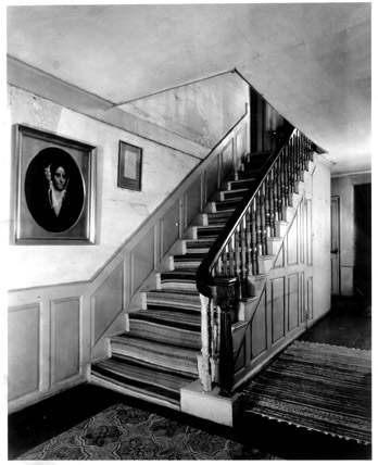 The central hallway and staircase of the Porter-Phelps-Huntington house. This historic photo of the home shows what it may have looked like when Doris lived here. -