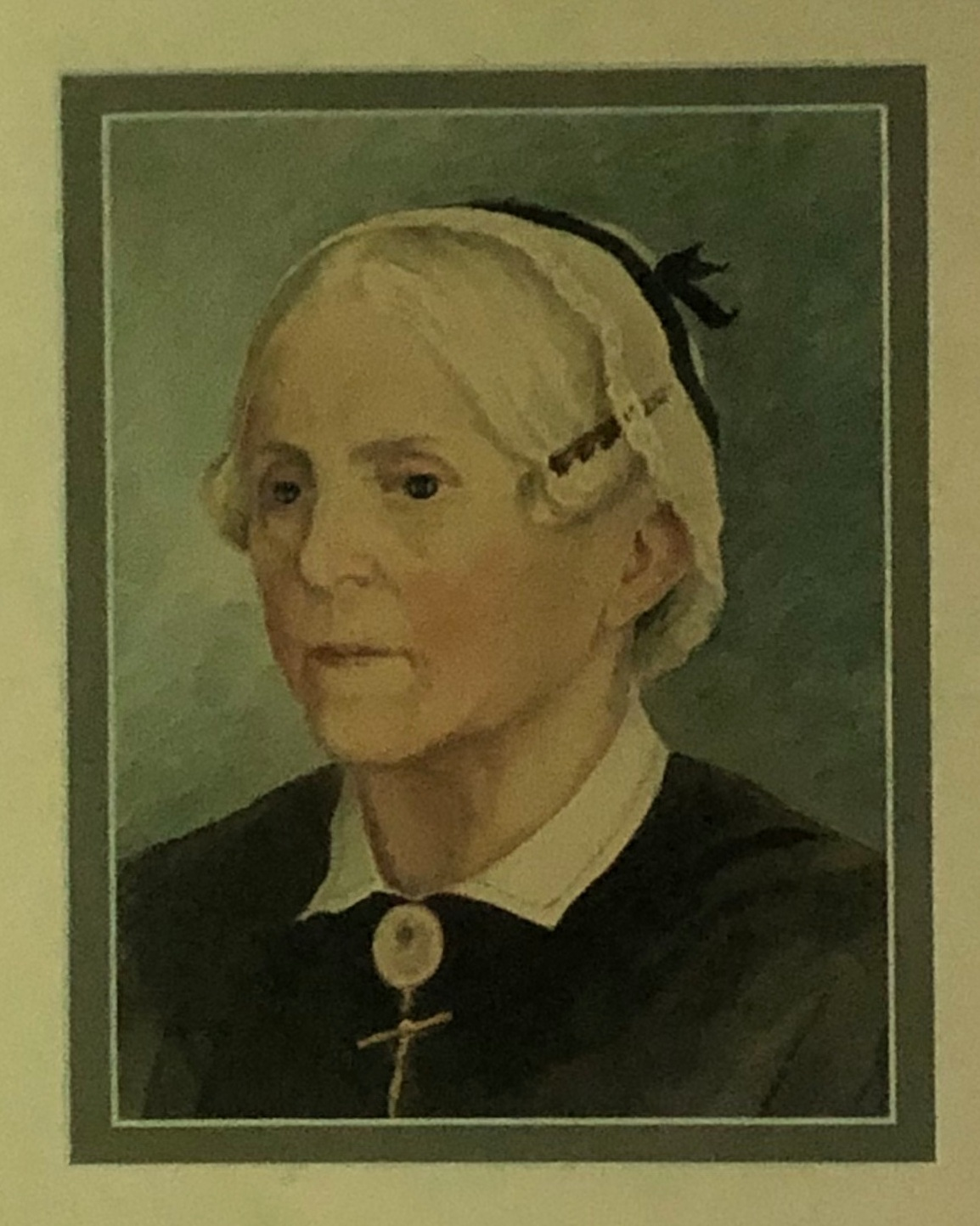 """A portrait Sarah Phelps by her niece Ellen Bullfinch.   """"Our glance rests more gladly upon the gentle lady herself, portrayed as we last saw her, with the lace cap on her soft white locks and the bit of black velvet at one side, which brought out the rosy softness of her cheek.""""   [2]"""