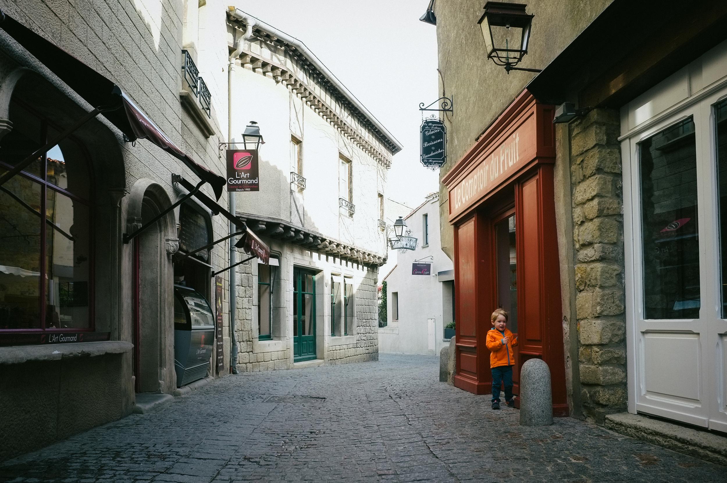 Boy in orange. Carcassonne