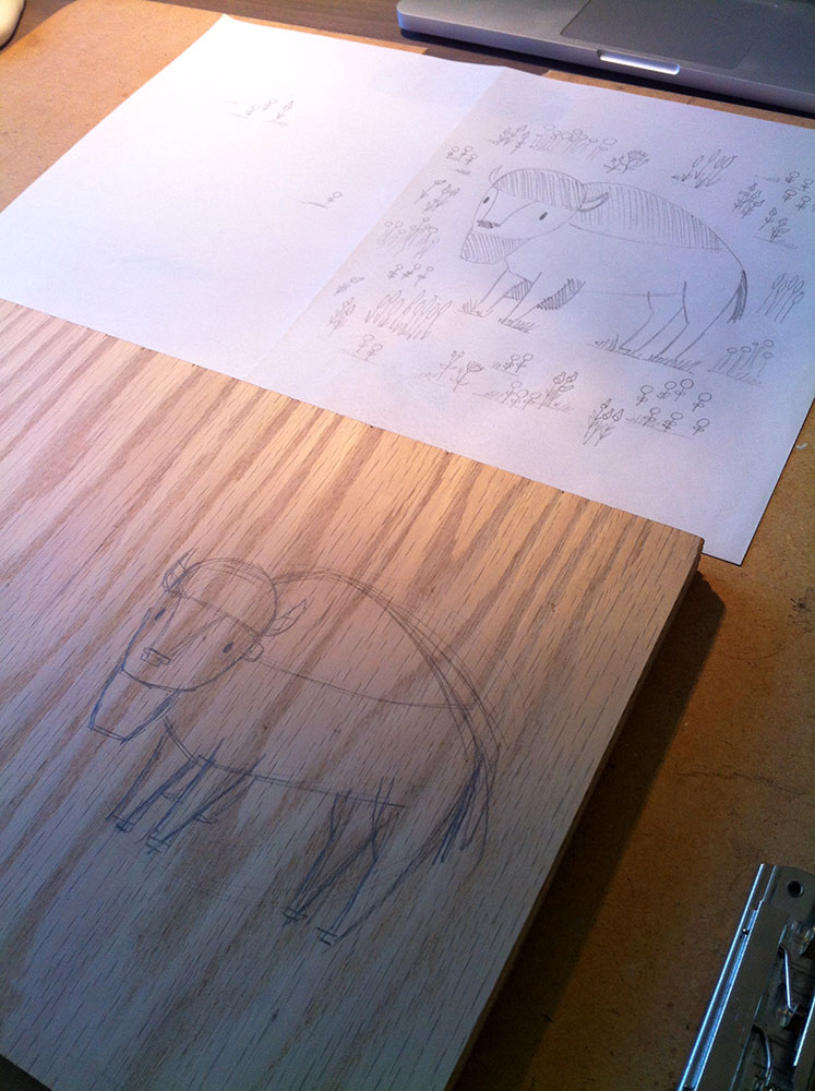 sketching main image on wood panel from full size layout