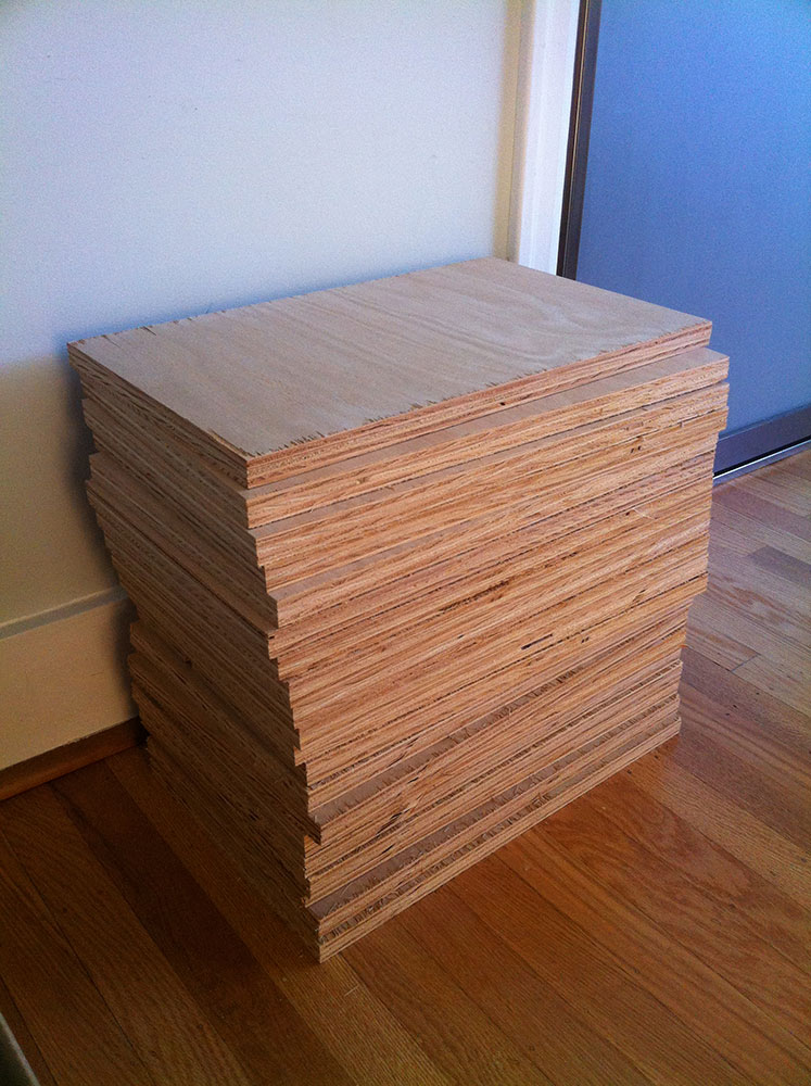 stack of wood panels for book spreads