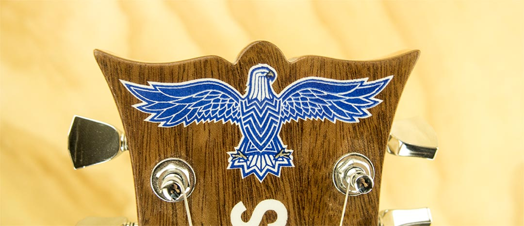Headstock Graphic detail - Design and 3 spot color screen print by Jacob Swogger for MPLS Instrument Company.