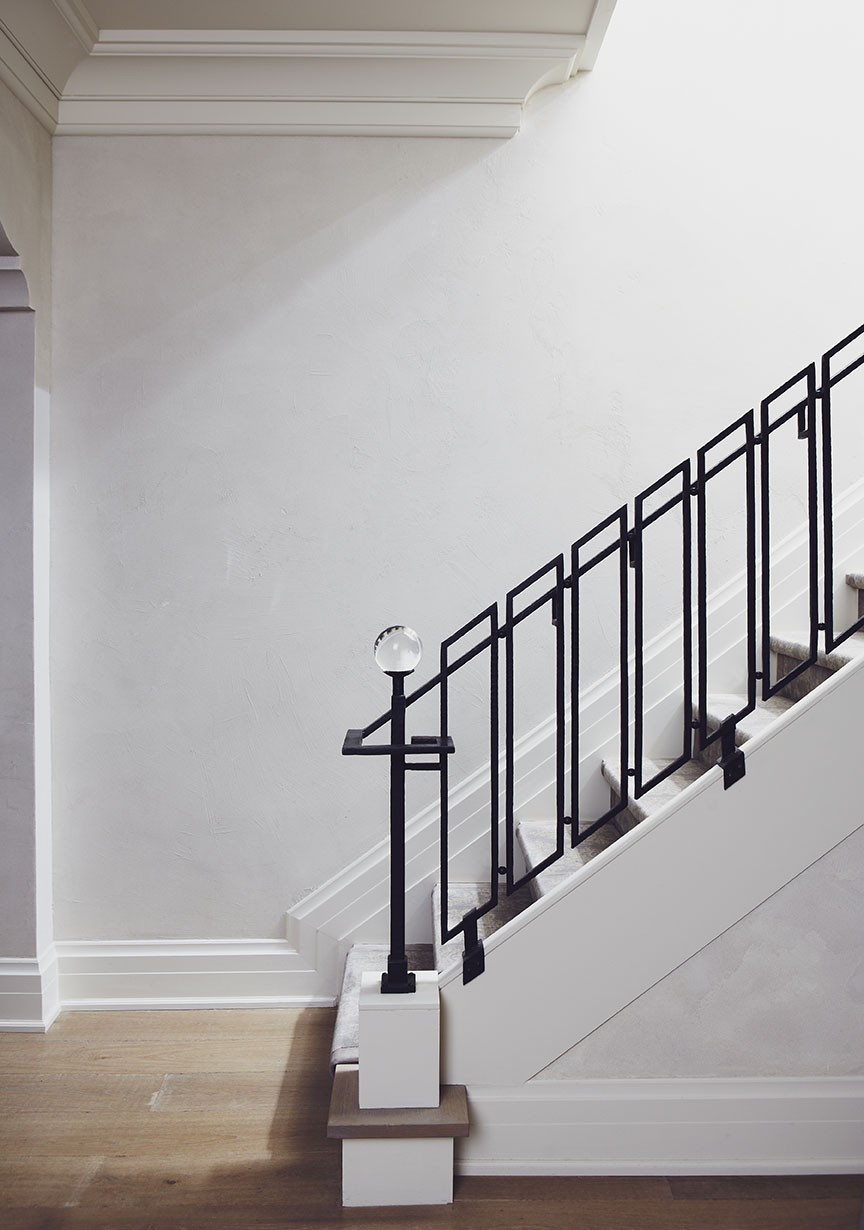 In this Victorian century home, the decision was made to remove the stairs and rebuild larger, more comfortable steps. Historic treatment was applied in a contemporary way, using forged iron with a hammered finish for the railing. A wax coating eliminates rust and tarnish while a crystal ball adds a unique touch at the end of the newel post.