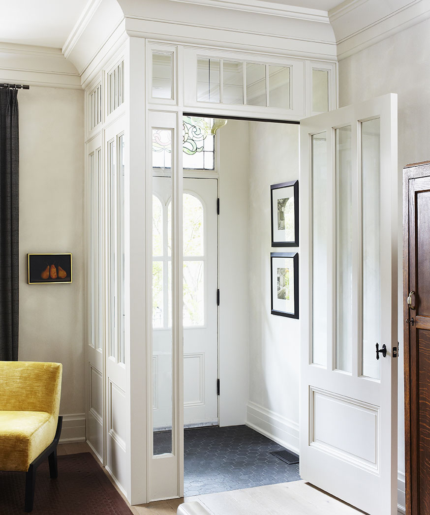 In this previously badly renovated Victorian century home, we wanted to create a contemporary interior while respecting the architecture and historic interest of the home. Preserving the original stained glass, we transformed an old drywall box foyer into an open, light-filled entry vestibule. Recessed panels and glass block cold air while letting light flow freely, with views from one end of the home to the other.