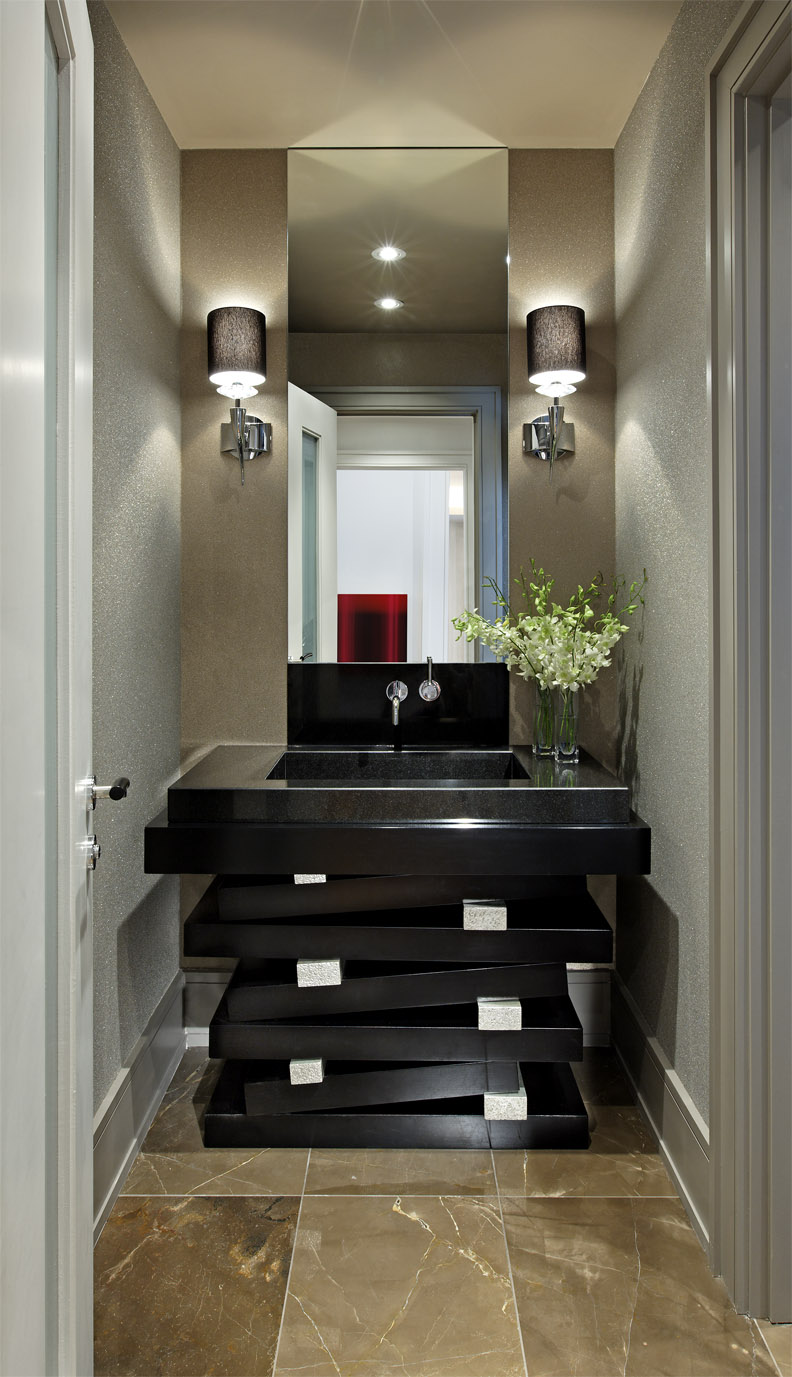 Repetition of curved or staggered and stacked shapes was a key element in our design for this young family's new home. Glossy black stacked and staggered vanity layers contrast dramatically against the shimmering glass bead and mirror surfaces in this glamorous powder room.