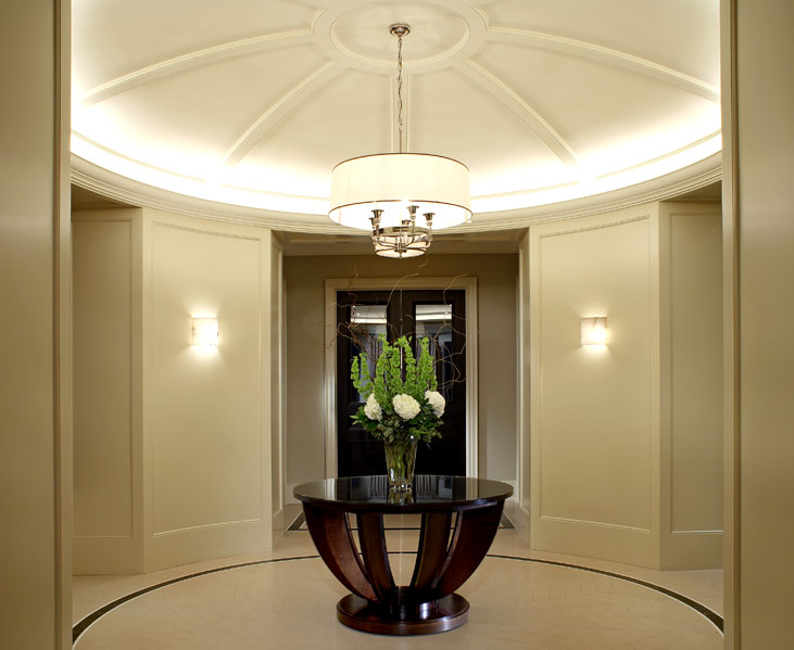This client wanted his new home to celebrate his North American achievements and European heritage. After conceiving all the interior volumes and spaces, we used a variety of motifs, textures and patterns so that each room has its own mood, yet a common richness unites the home. The exquisitely detailed rotunda is typical of the graceful balance achieved throughout.
