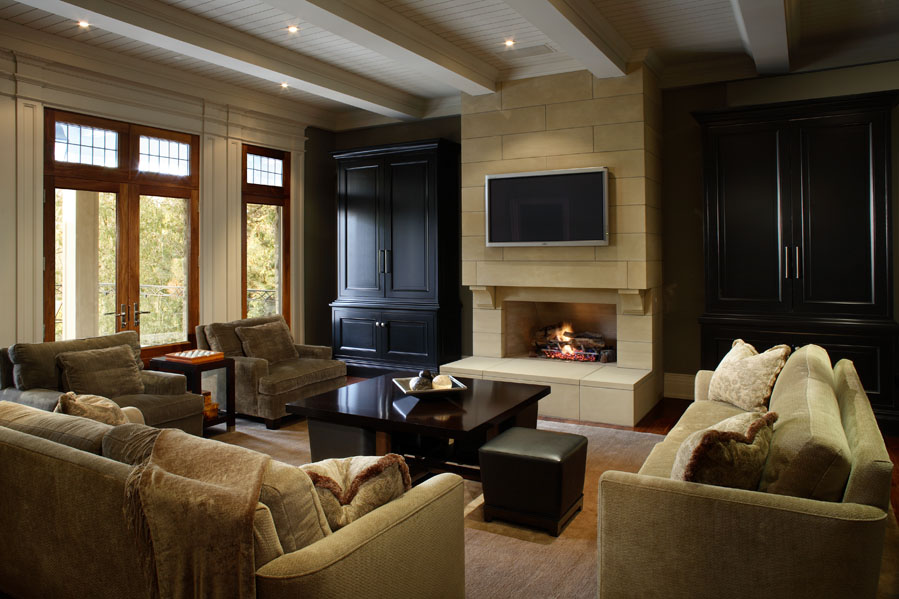 This client wanted his new home to celebrate his North American achievements and European heritage. After conceiving all the interior volumes and spaces, we used a variety of motifs. The warm family room features a large modern limestone fireplace and thoughtfully designed cabinetry housing children's toys, home theatre equipment and other items supporting the owner's family-and entertainment-oriented lifestyle.