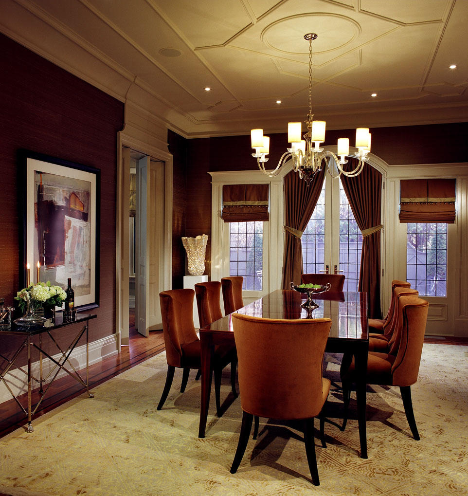This client wanted his new home to celebrate his North American achievements and European heritage. After conceiving all the interior volumes and spaces, we used a variety of motifs, textures and patterns so that each room has its own mood, yet a common richness unites the home. The Chippendale inspired ceiling and millwork details subtly contrast with the contemporary mid-century furnishings.