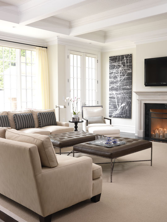 Although they love traditional design, this Florida-based couple wanted their Canadian summer home to be a fresh, light and lively place for the whole family, including very young children and a dog. We gave them the freshness that reflects their lifestyle, while respecting the neoclassical character of the home. In the light-bathed family room, clean-lined low furnishings add warmth and comfort while modern artwork contrasts with the classic millwork details.