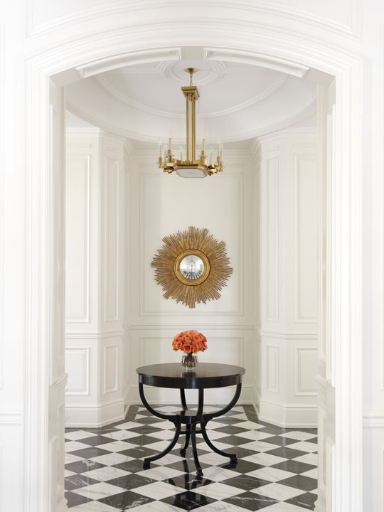 Although they love traditional design, this Florida-based couple wanted their Canadian summer home to be a fresh, light and lively place for the whole family, including very young children and a dog. The simplicity and freshness of the interiors reflects their lifestyle, while respecting the neoclassical character of the home, as exemplified in this classically detailed foyer enlivened with only three special furnishings.
