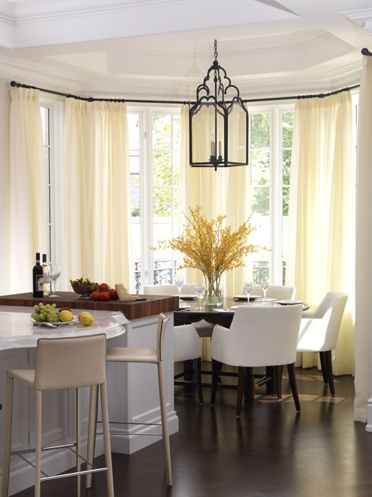 Although they love traditional design, this Florida-based couple wanted their Canadian summer home to be a fresh, light and lively place for the whole family, including very young children and a dog. This bright, sun-washed breakfast room reflects their lifestyle with smart contemporary leather chairs contrasting with the existing rustic table amid the home's neoclassical details.