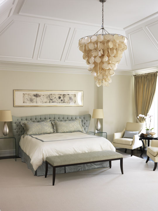 Although they love traditional design, this couple wanted their Canadian summer home to be a fresh, light and lively place for the whole family, including very young children and a dog. We gave them the freshness that reflects their lifestyle while respecting the neoclassical character of the home. The most contemporary room, the master bedroom features shell motifs reflecting their Floridian origin. The Italian-designed bed's button tufted suede, the handmade silver lamps and '30's Art Deco chairs add soft layers of richness and contemporary elegance.