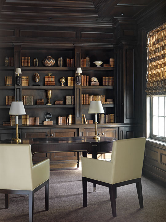 The Georgian-styled, Canadian summer home we created for this Florida-based couple reflects a lifestyle with very young children, a dog and a busy social calendar. We designed the study library as a quiet, sober retreat with its rich, dark colours and traditionally detailed bookcases and wall panelling contrasting with the spare elegance of the Lucien Rollin Art Deco desk and simple leather chairs.