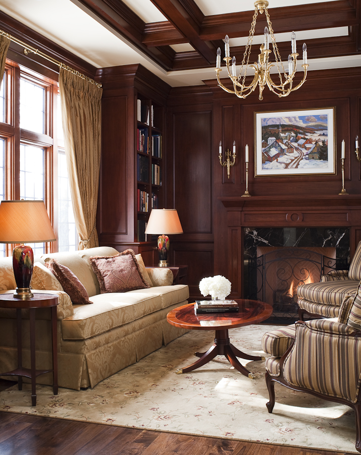 For this custom-built traditional home, we worked closely with the architect to refine the millwork details, then worked with the owners to place and enhance their existing furnishings and art collection. In the library, we employed carpeting, draperies and cushions to underline the cozy feeling established by the stained wood panels and create a backdrop for the Moorcroft lamps and early 20th century Quebec painting.