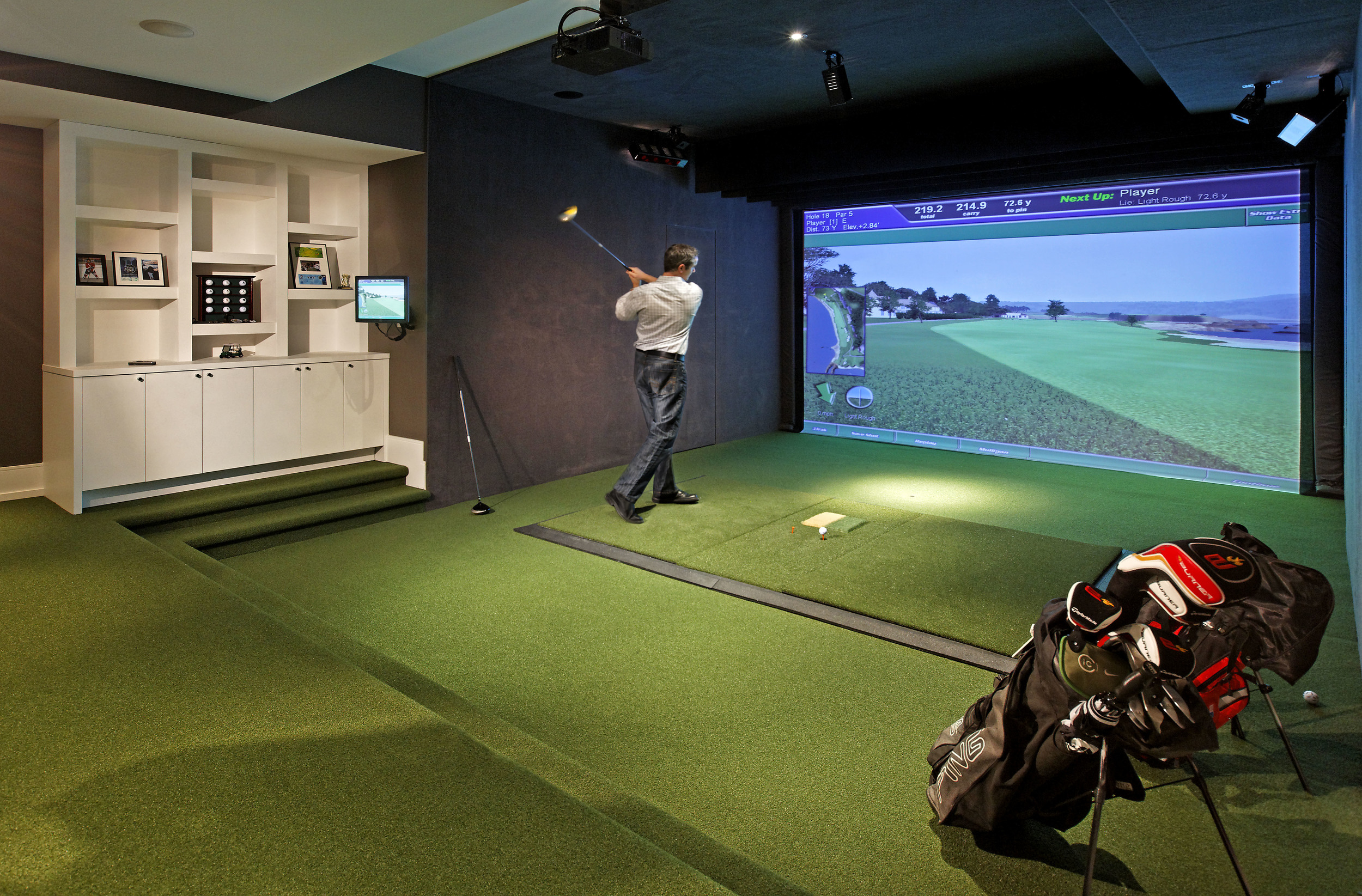 One of the objectives for this long-awaited, custom-designed dream home was that it would suit all aspects of the family's lifestyle. On the lower level, this indoor virtual golf simulator room was created for an avid golfer, but will easily transition to a home theatre as his young family grows.