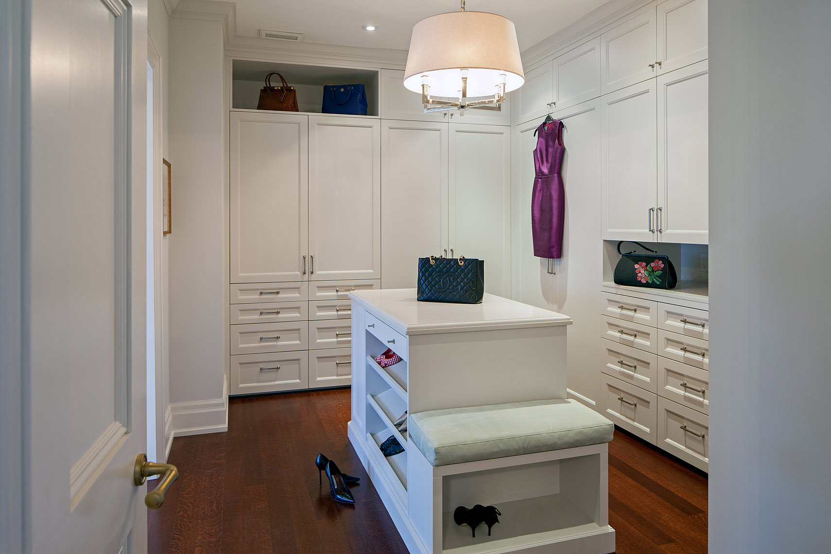 This dressing room and closet was painstakingly detailed to accommodate multi-level hanging, many drawers, shelving and open storage. Despite the extensive cabinetry, this passageway between the master bedroom and ensuite is light, fresh and spacious.