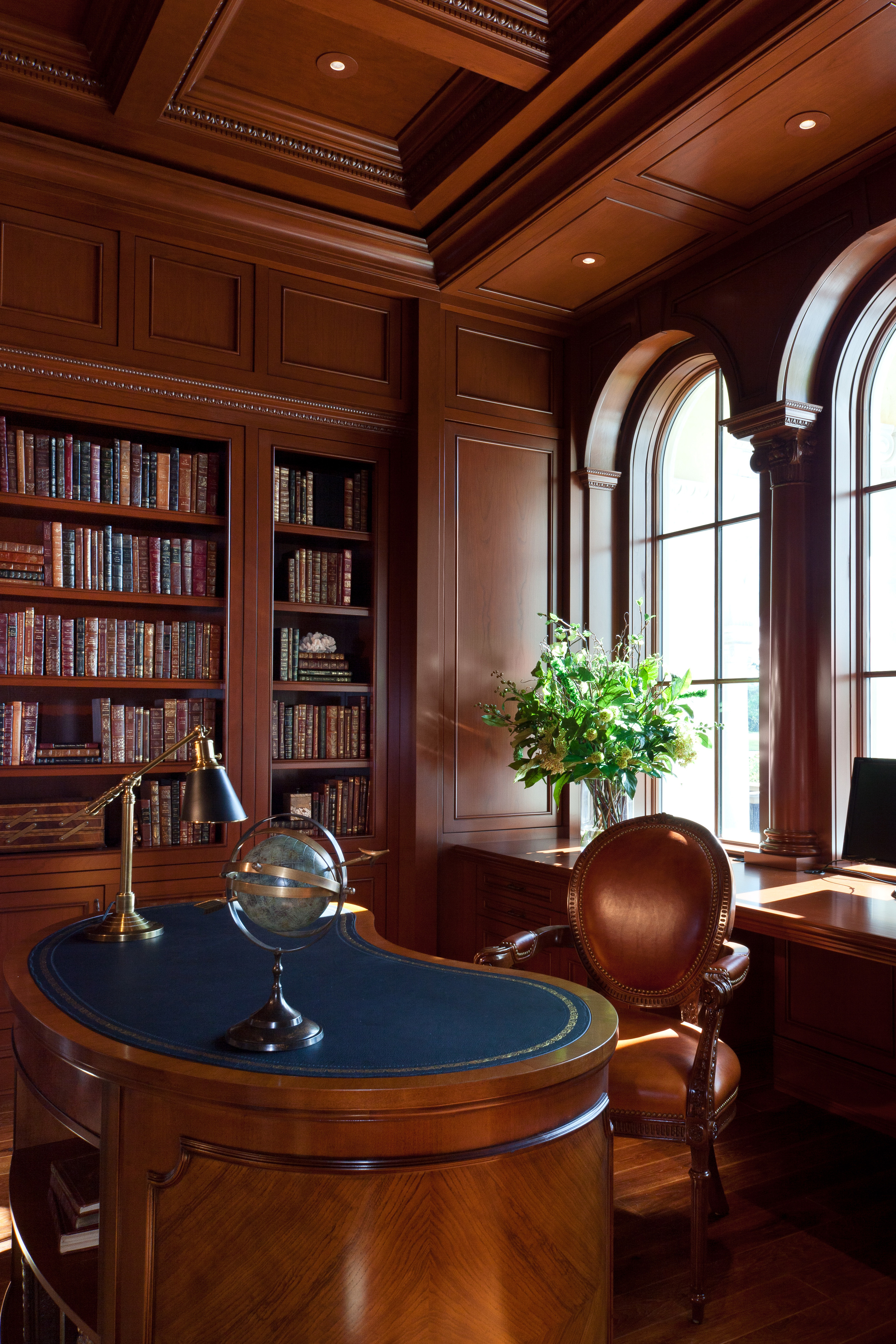 This vacation home is replete with custom cabinetry and finely detailed millwork, as epitomized by this inviting and functional study, which is perfectly planned and executed in rich cherry wood. Hidden in the window frame, remote controlled blinds descend to block the Florida sunshine.