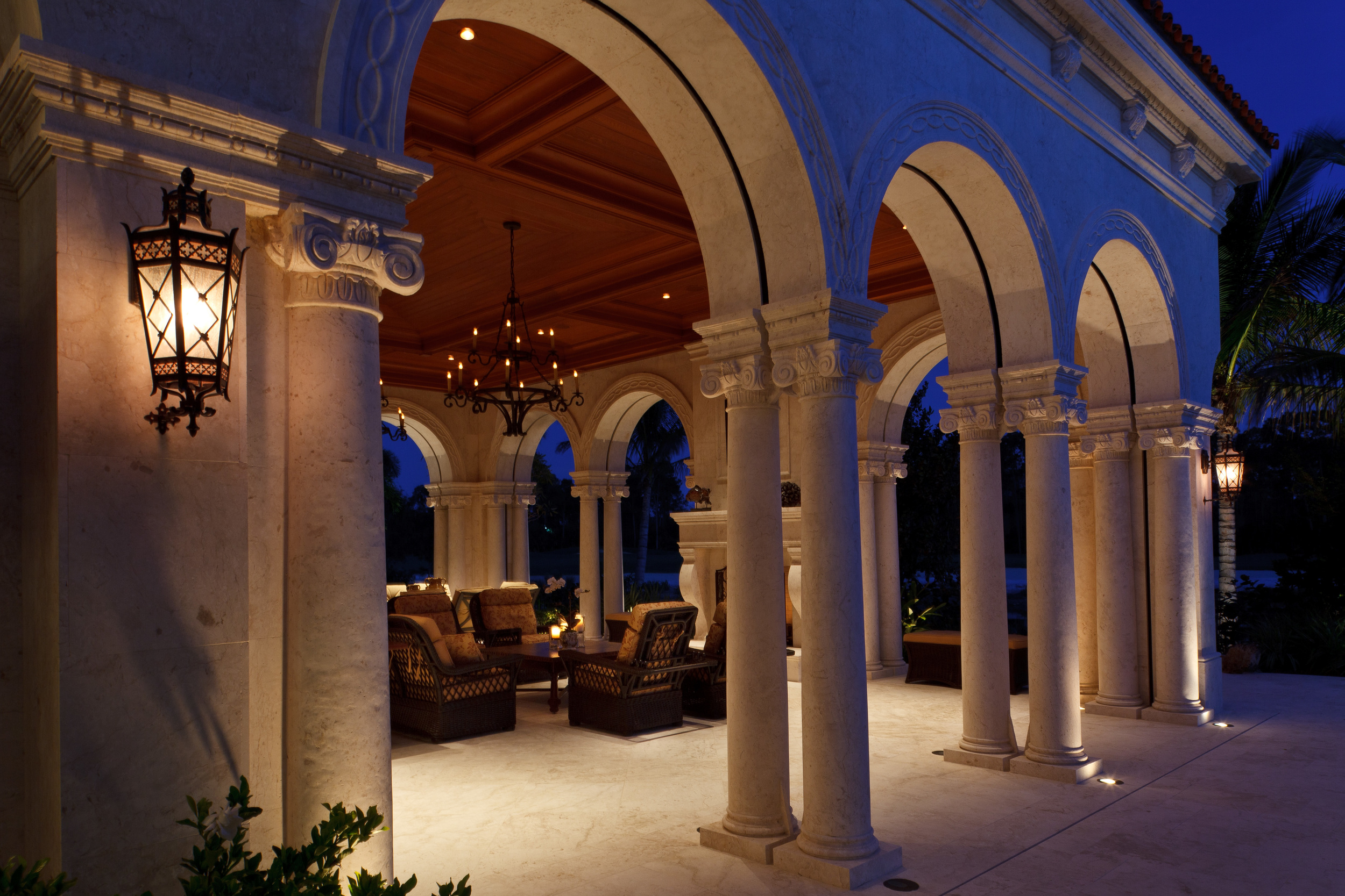 Interior and exterior details were coordinated to create a consistent and elegant Spanish Moorish character. The columns and ceiling of this welcoming lanai are typical of the exhaustive and inventive design detailing throughout the Florida home.