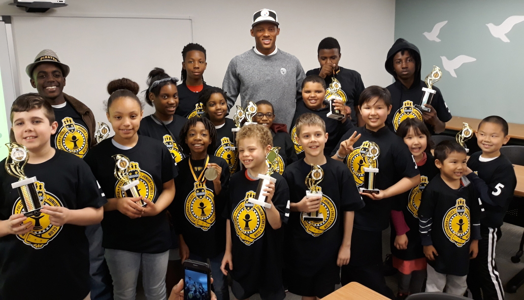 Josh Dobbs and the incredibly smart and adorable Pittsburgh Police Junior Chess Club.