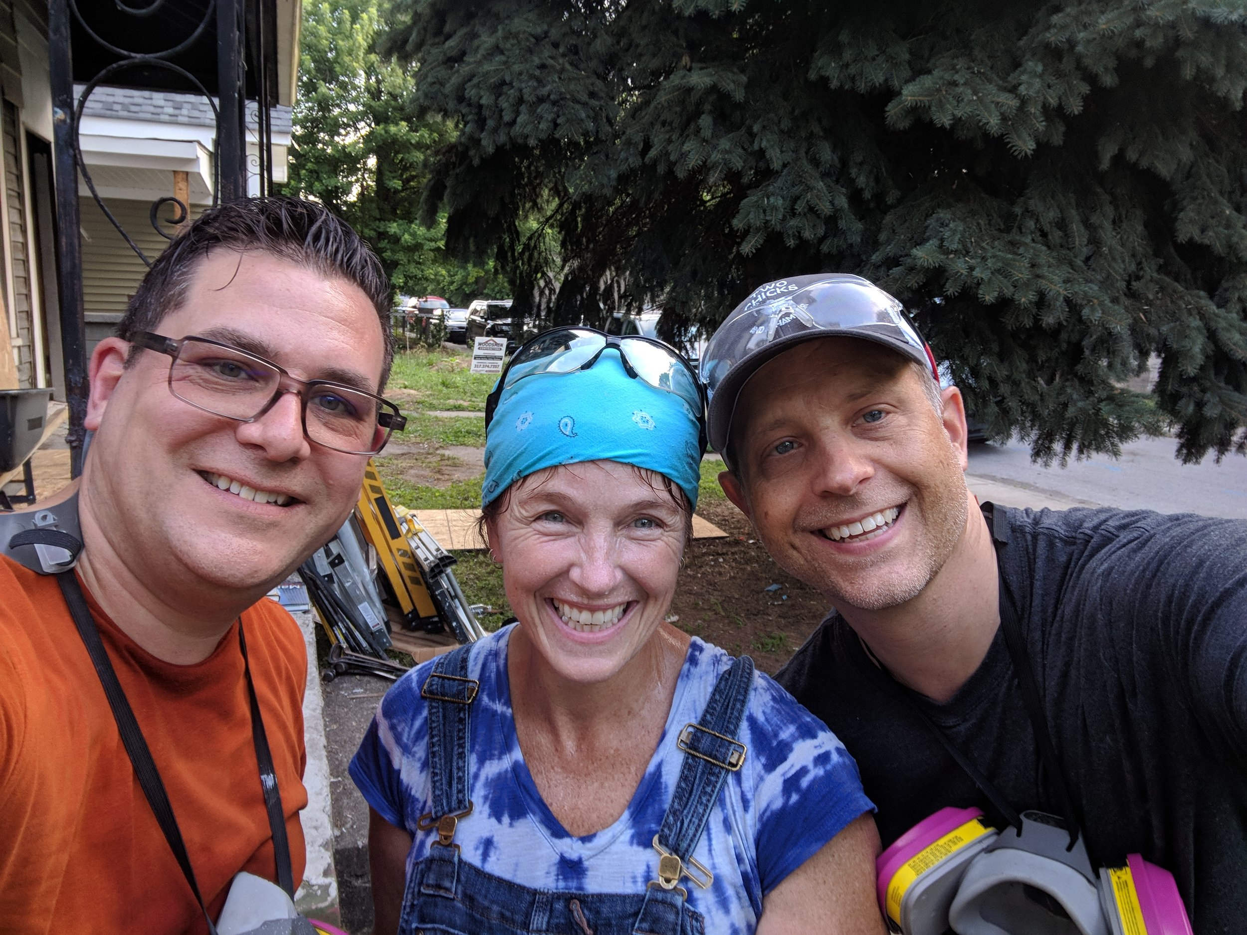 Rod, Karen, and Todd pause to take a selfie during a moment of filming the demolition on one of the houses
