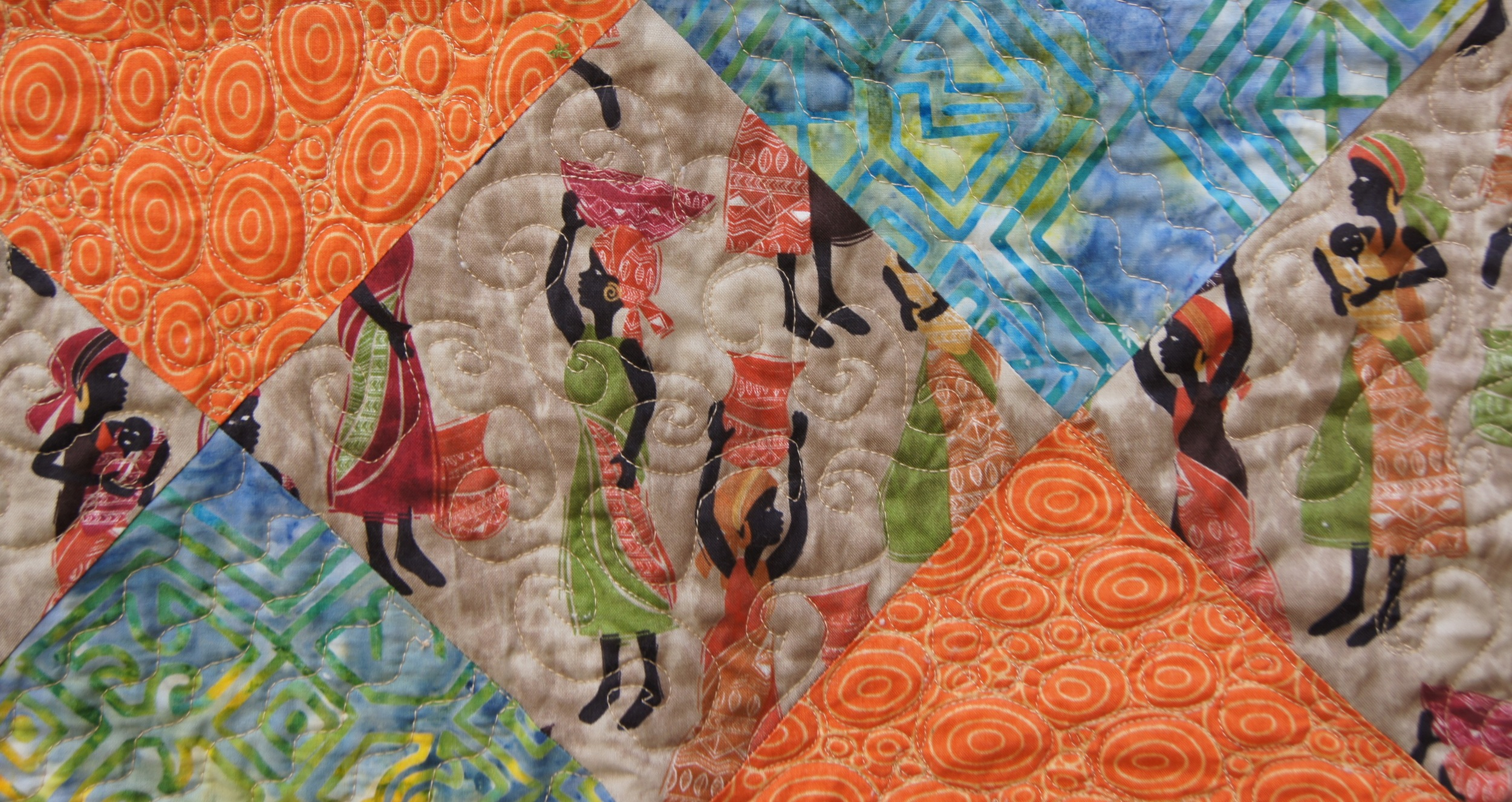 Bernina Stitch #4 to make the waves in the river blocks.  Free motion quilting to make the stream pebbles and swirls around the women.
