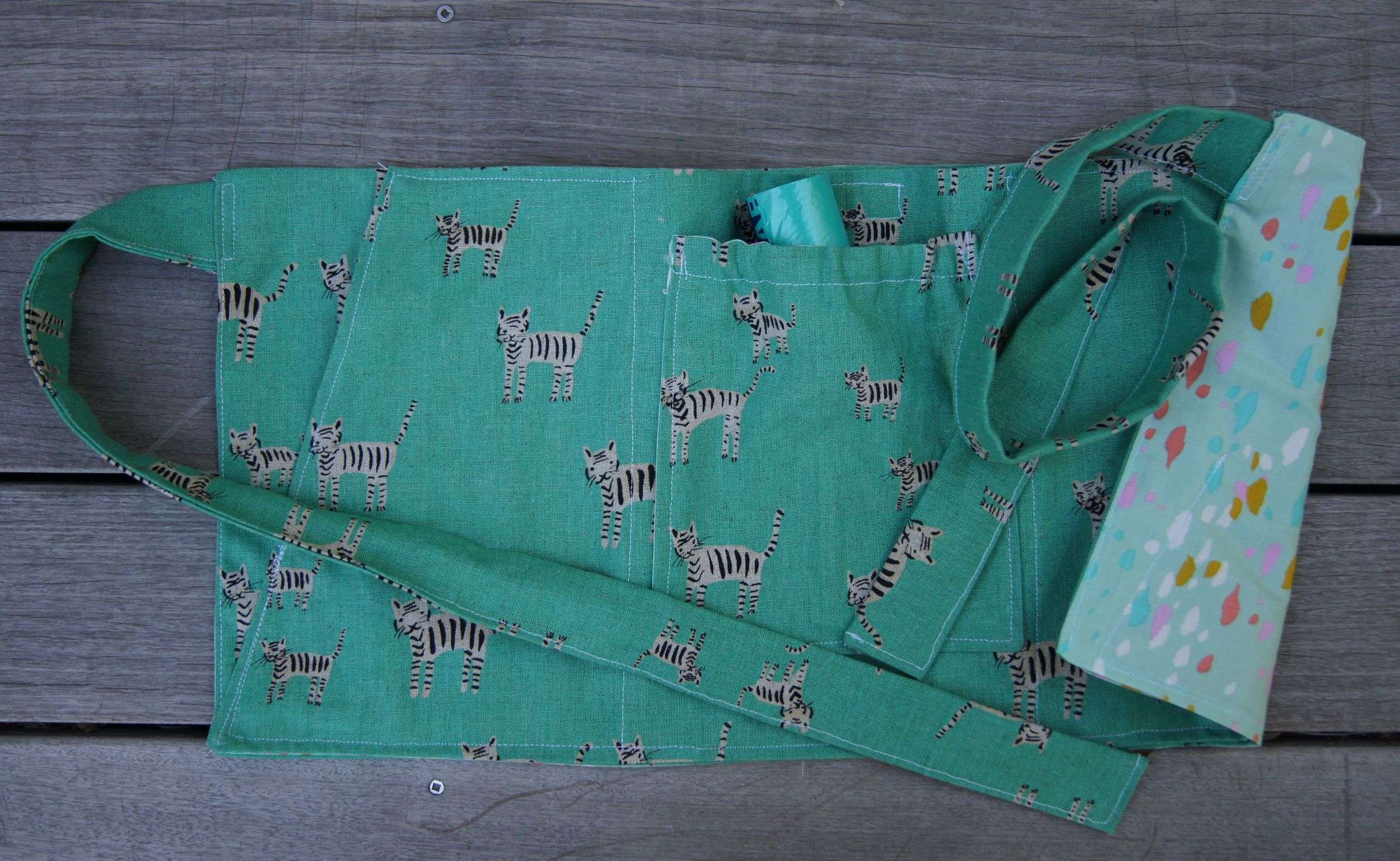 "Cotton + Steel fabrics: ""Tiger Stripes"" cotton canvas body, ""Stampede"" cotton lining"