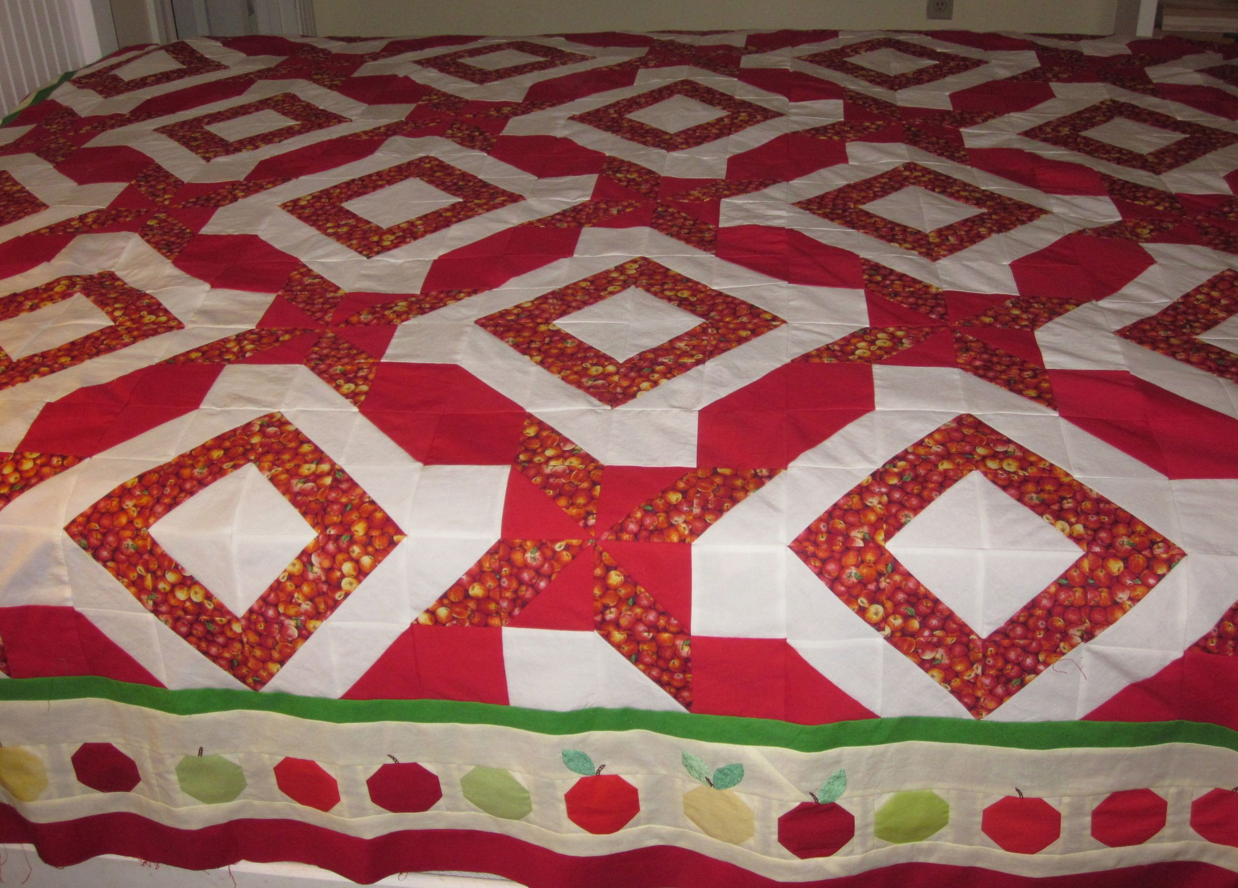Apple Picking Time quilt top. A Quilters Club of America Mystery Quilt. The apple border is my design.
