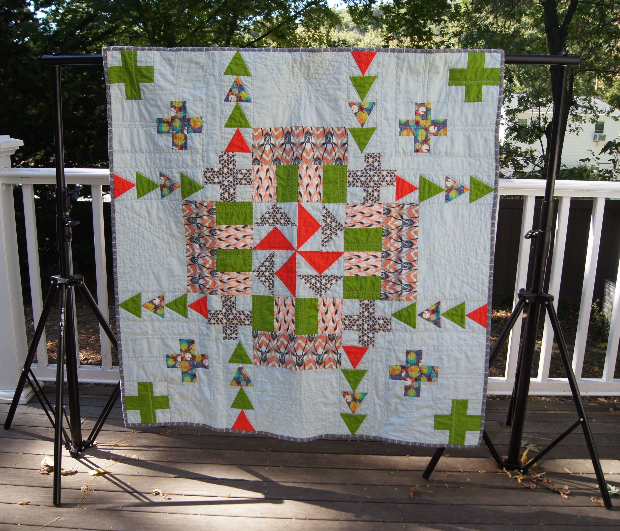 Square Perfect Backdrop frame holding a lap quilt