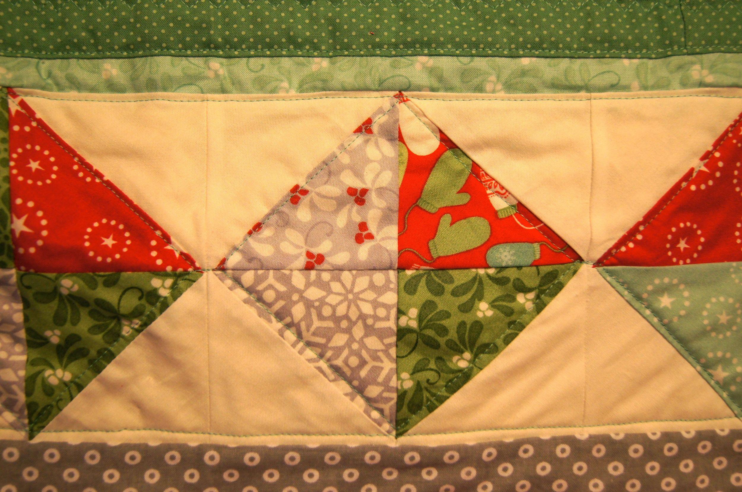 Half Square triangles compose diamond blocks for a Christmas quilt
