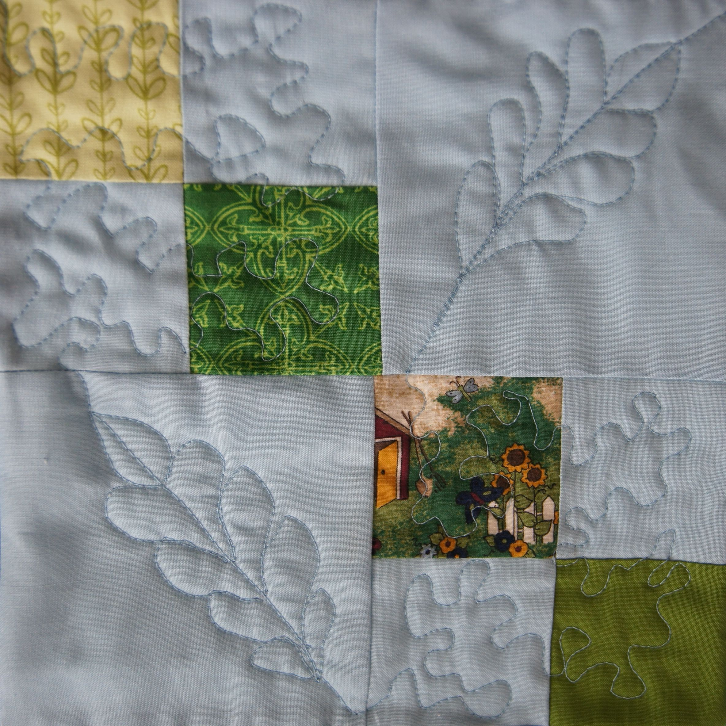 Feathers and meander quilting on chain block