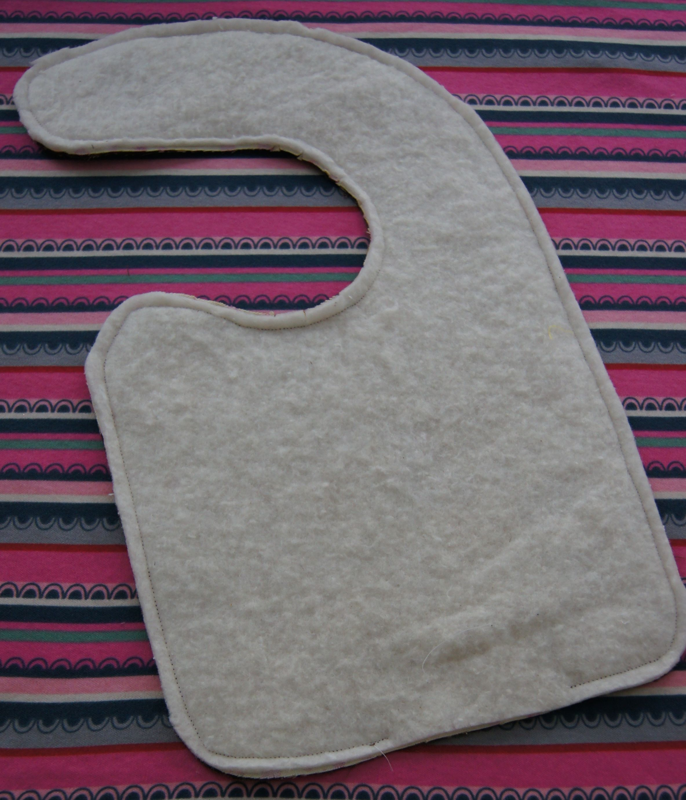 Quilt batting used as the absorbent middle layer of a bib