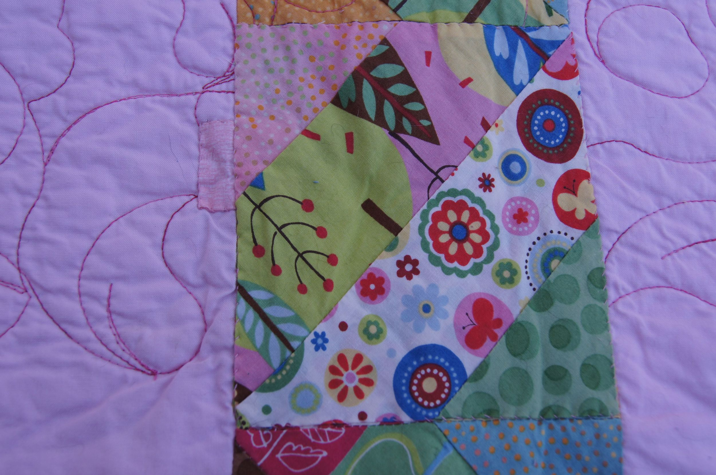 Mending on the back of Cats in Trees Quilt