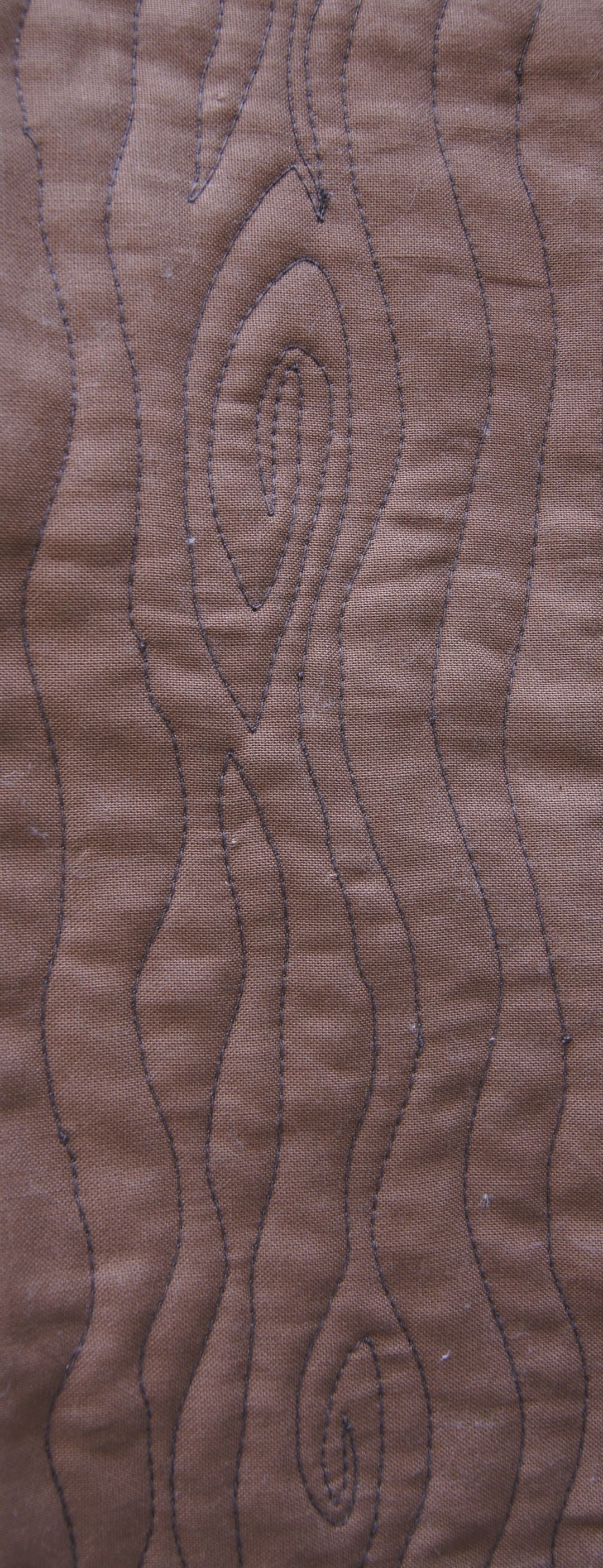 Quilting a wood grain pattern with free-motion quilting