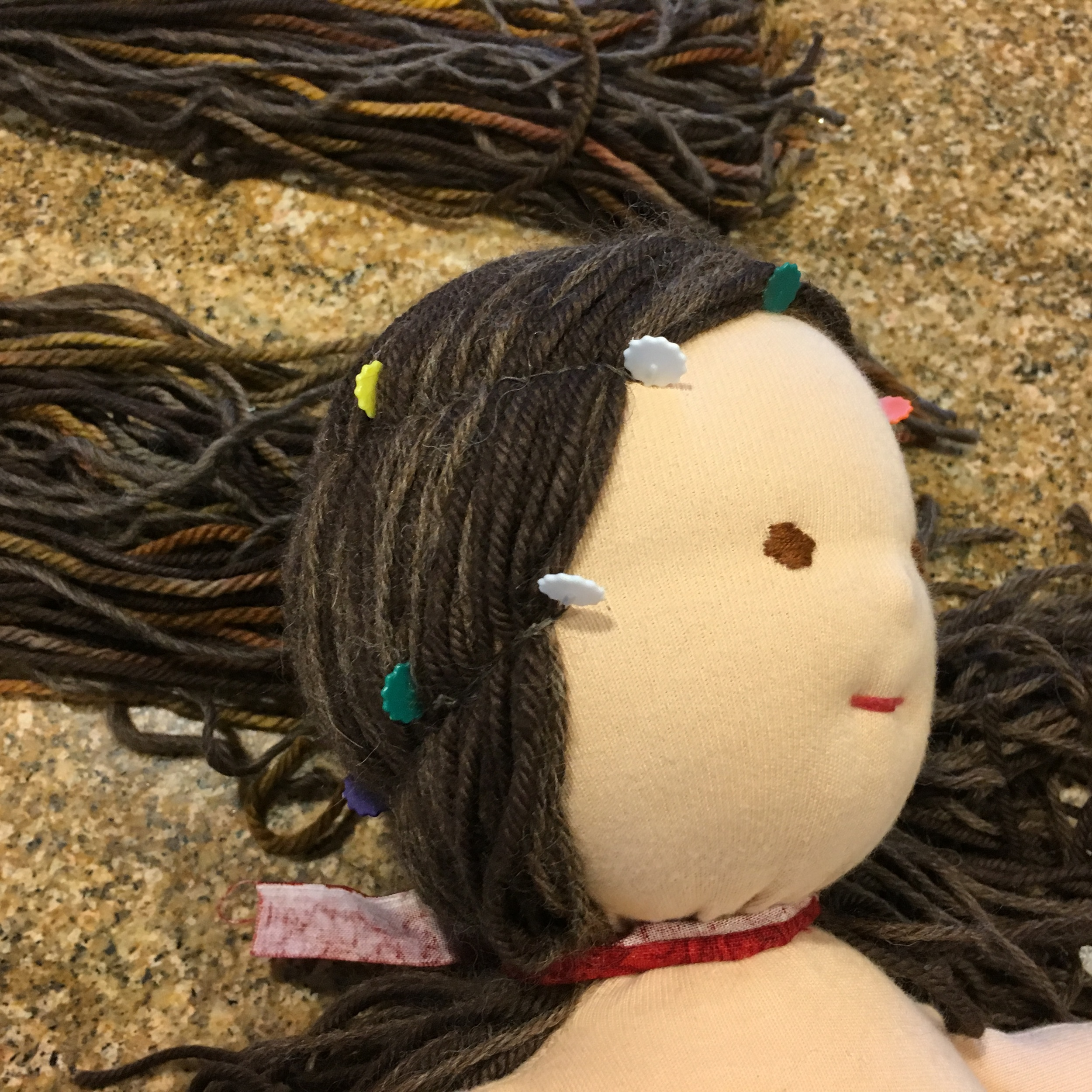Doll Hair stitching marked with flower pins.jpg