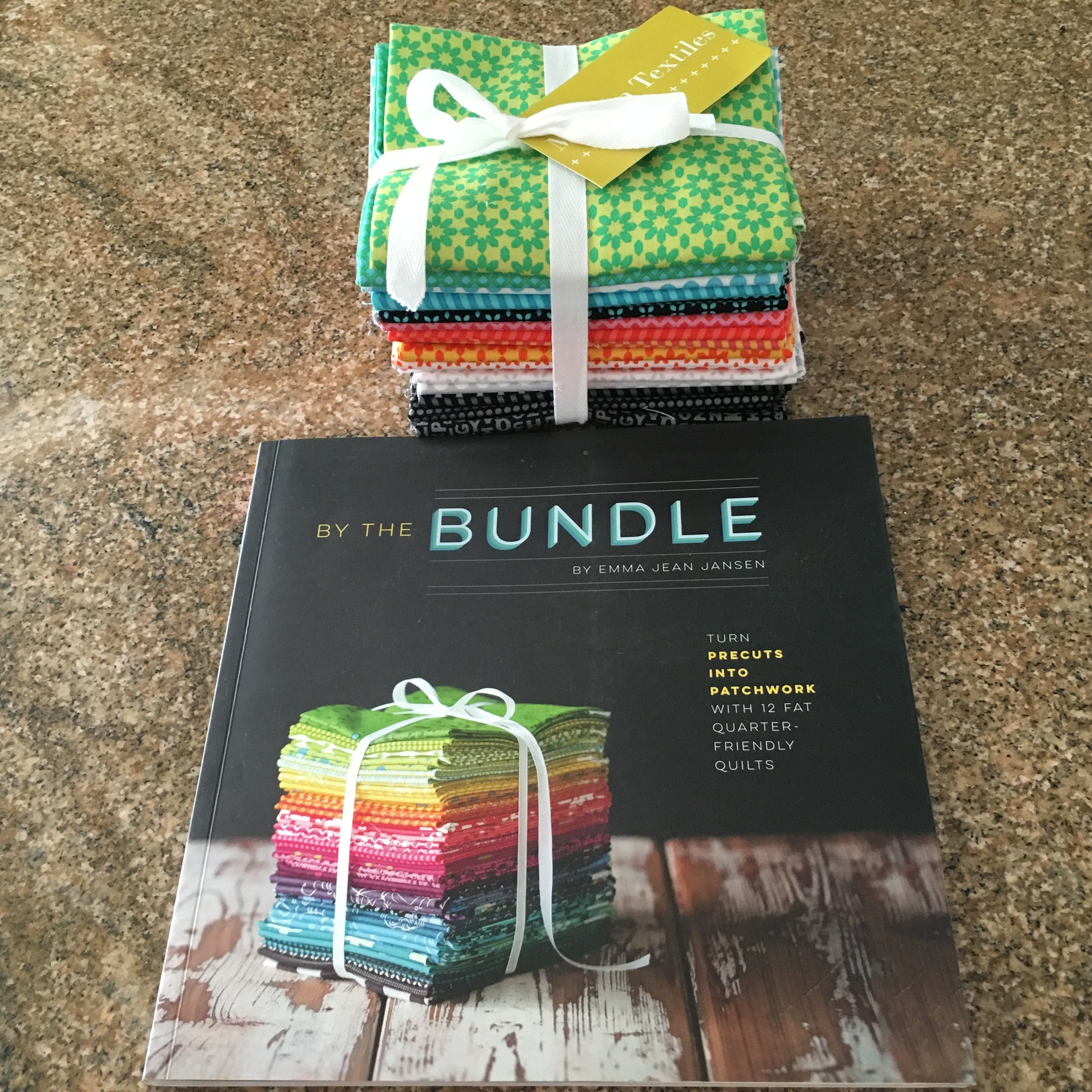 """The """" By the Bundle """" book with a 'short stack' of """" Uppercase """" FQs by Windham Fabrics, purchased at  Modern Textiles , Fargo, ND."""