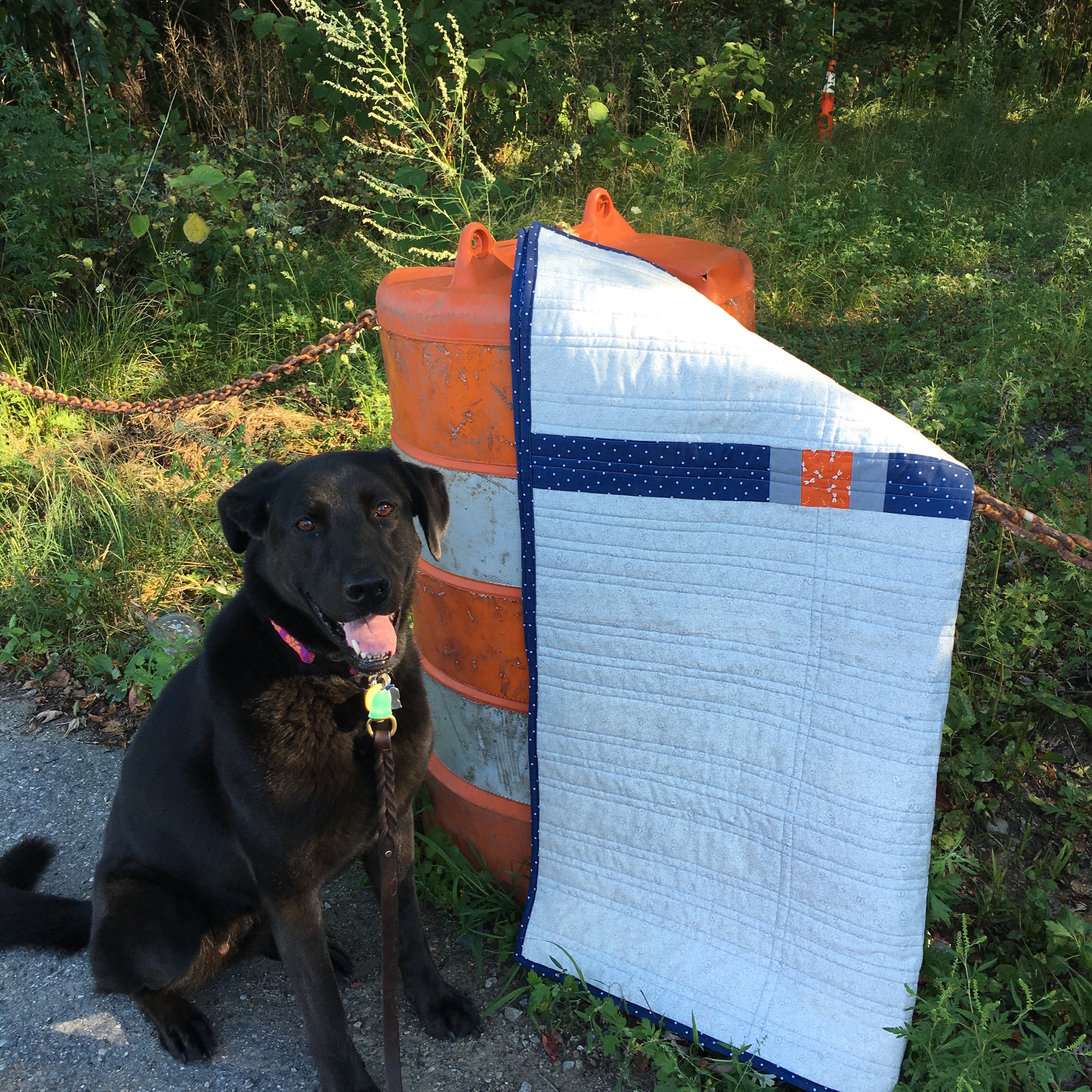 Hazel with a view of the back of the Indigo Color Quilt