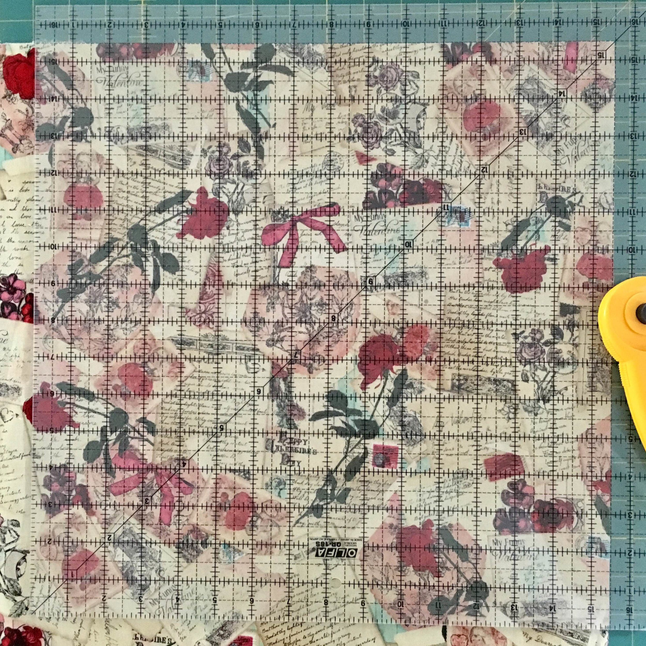 Using a quilting ruler to cut the cover