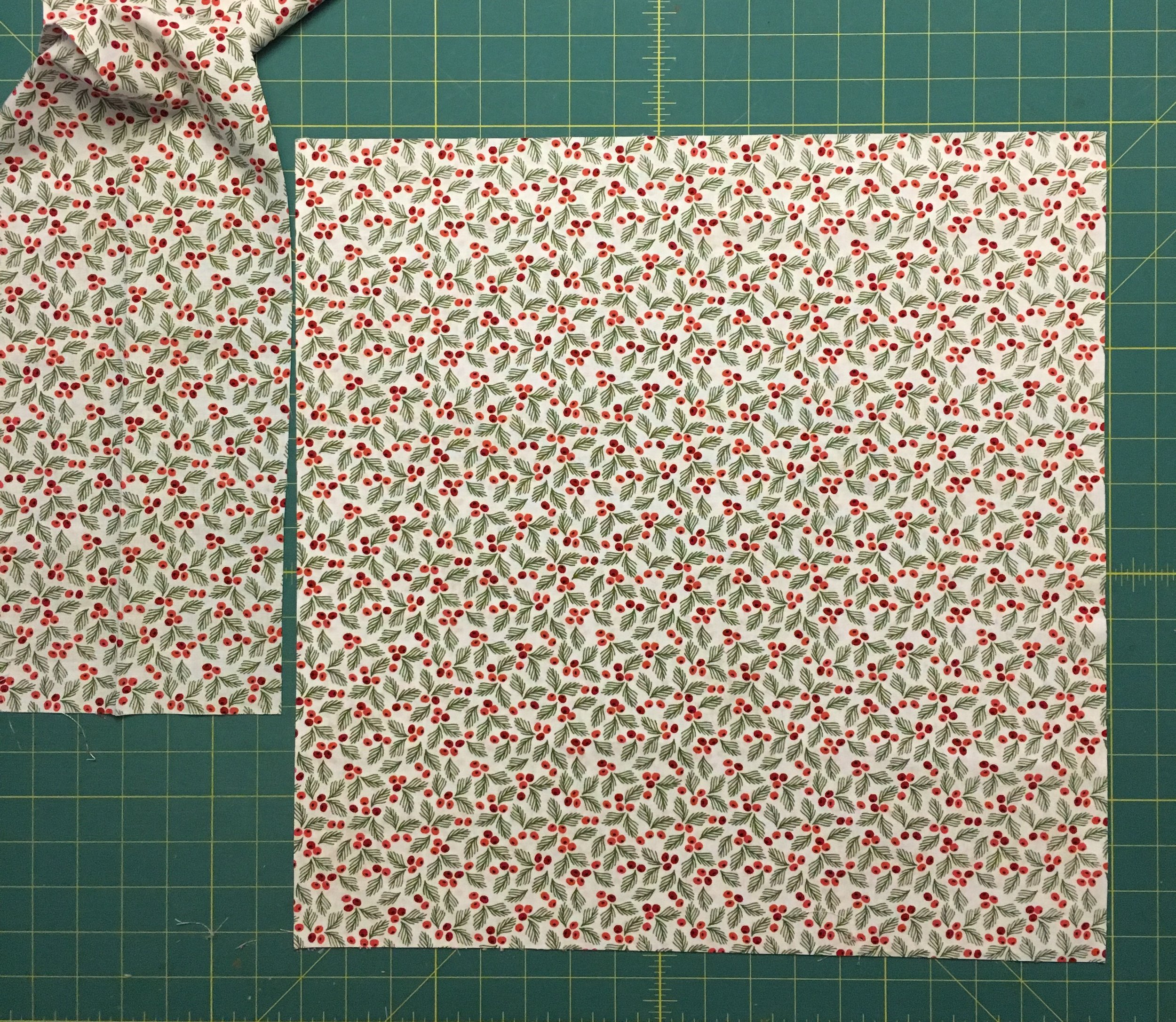 The cut napkin with the left over strip along the FOLD of the fabric.