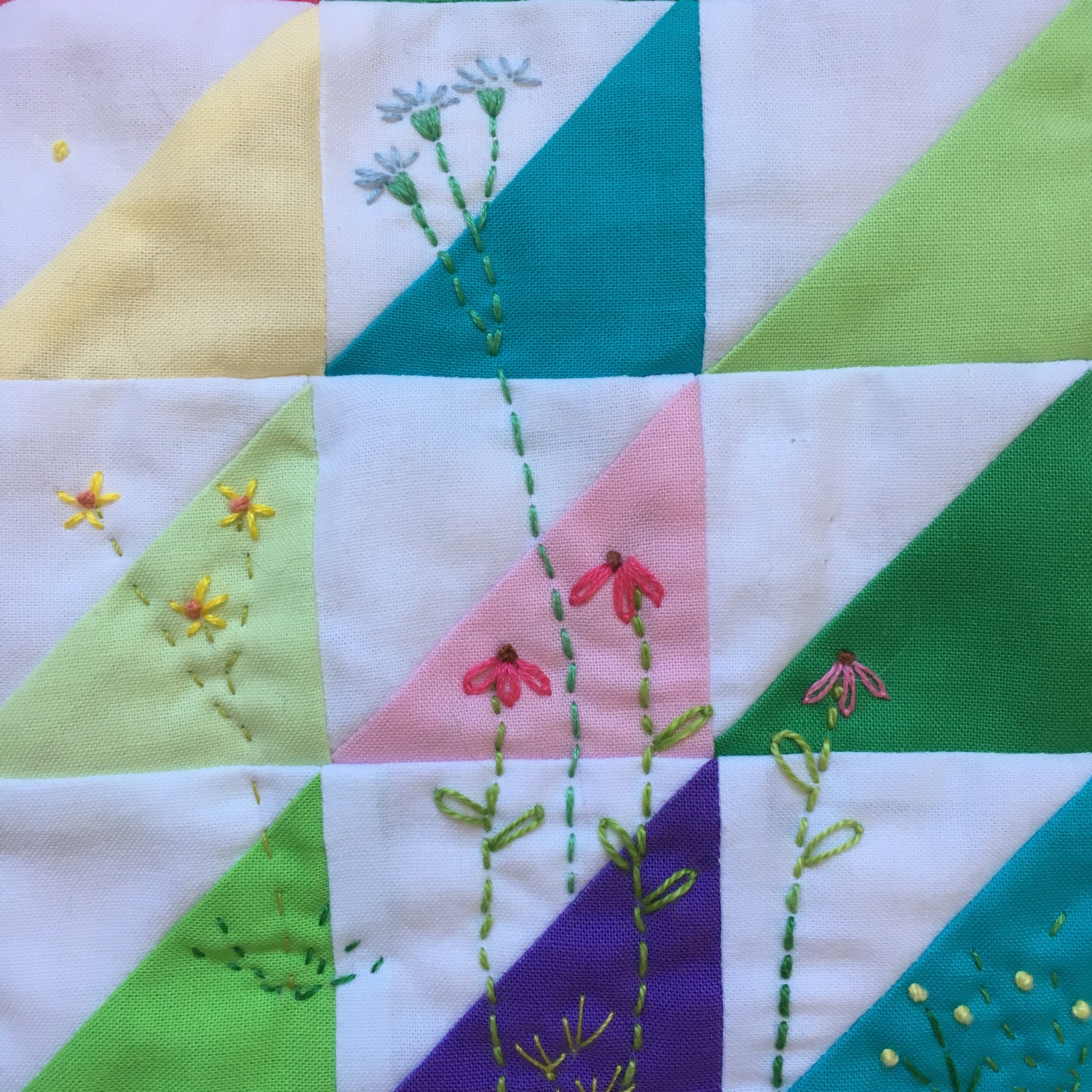 Detail of embroidered flowers on HST Mini Quilt
