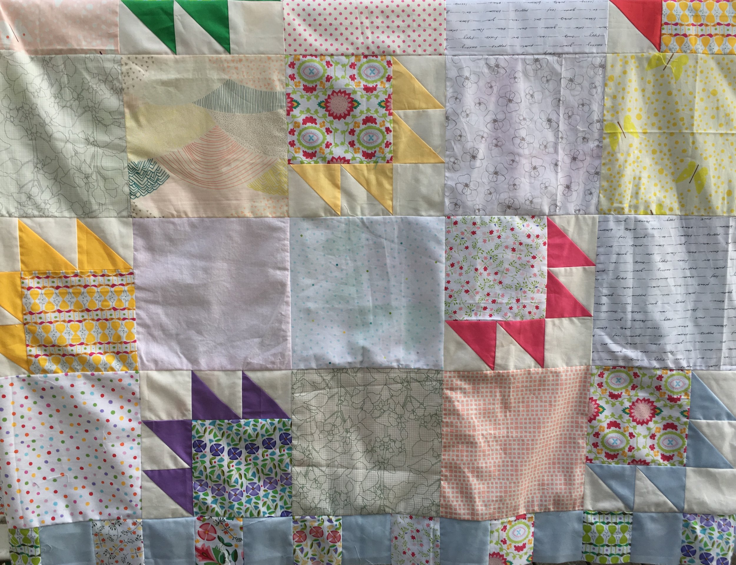Quilt top waiting to be sandwiched and quilted