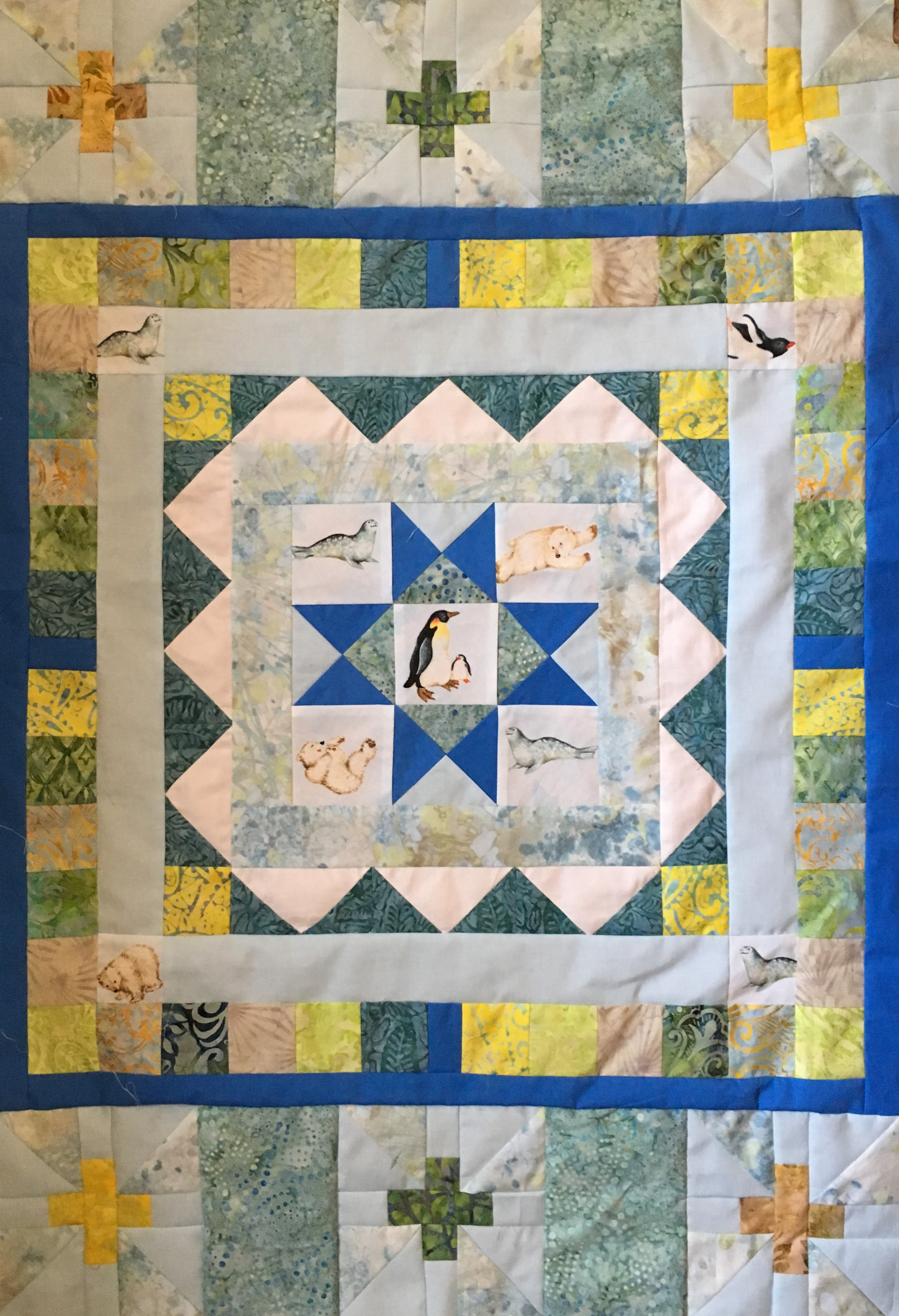 Quilt with strip sets added only to top and bottom changing the quilt to a rectangle.