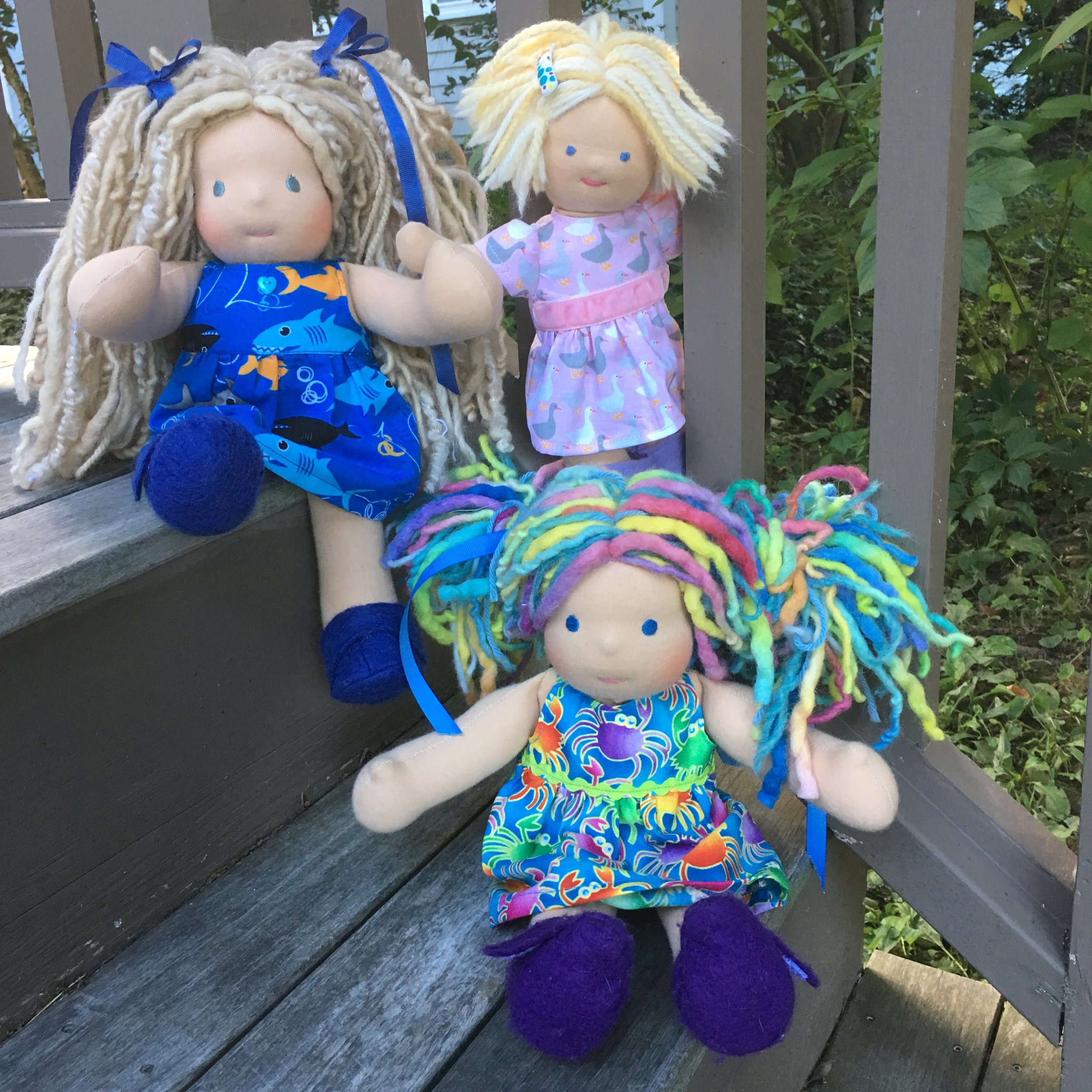 Summertime doll dresses:  sharks, crabs and ducks!   Bamboletta  Cuddle Dolls, left and right, my Waldorf type baby doll in the center.