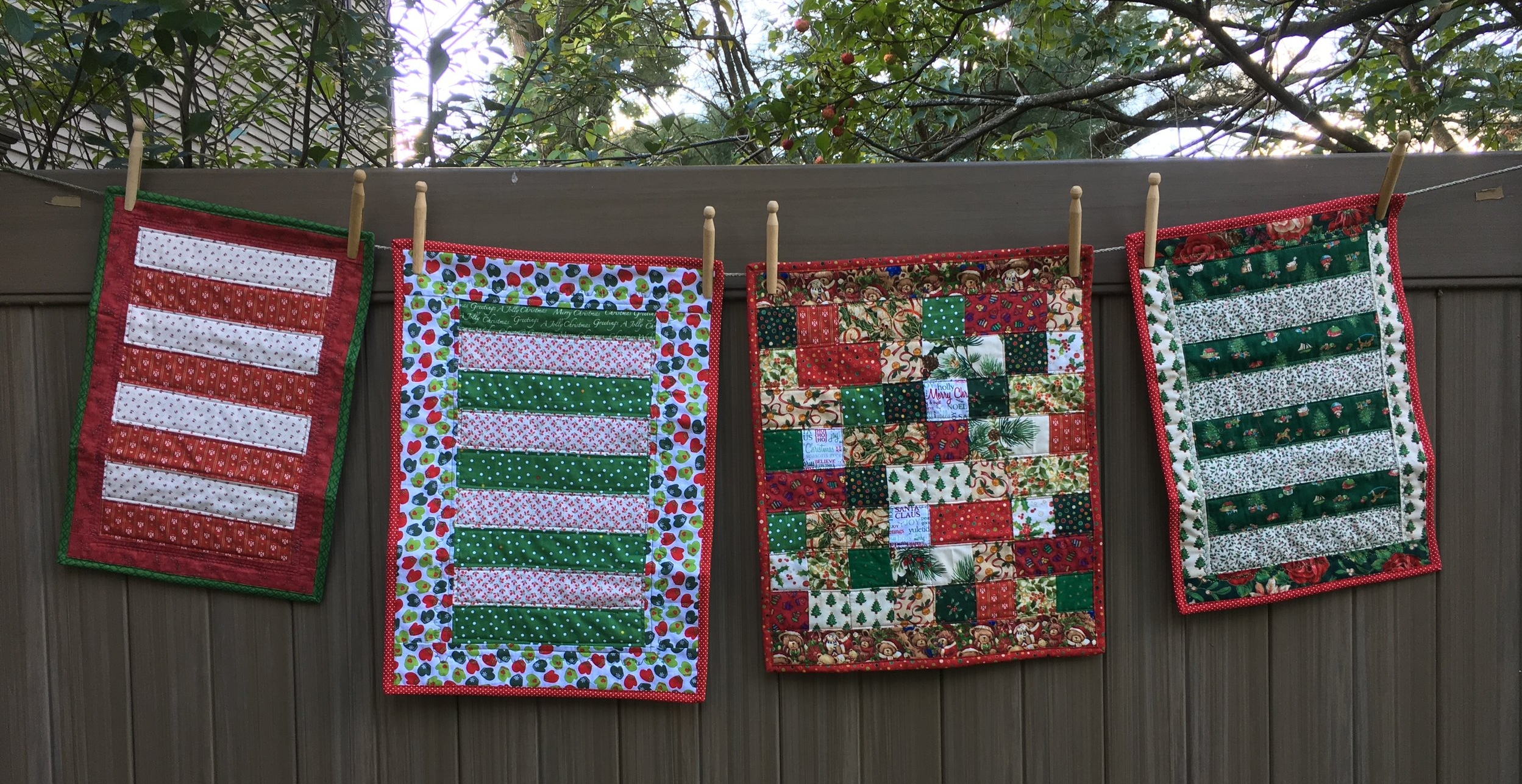 Doll Christmas quilts on the clothes line
