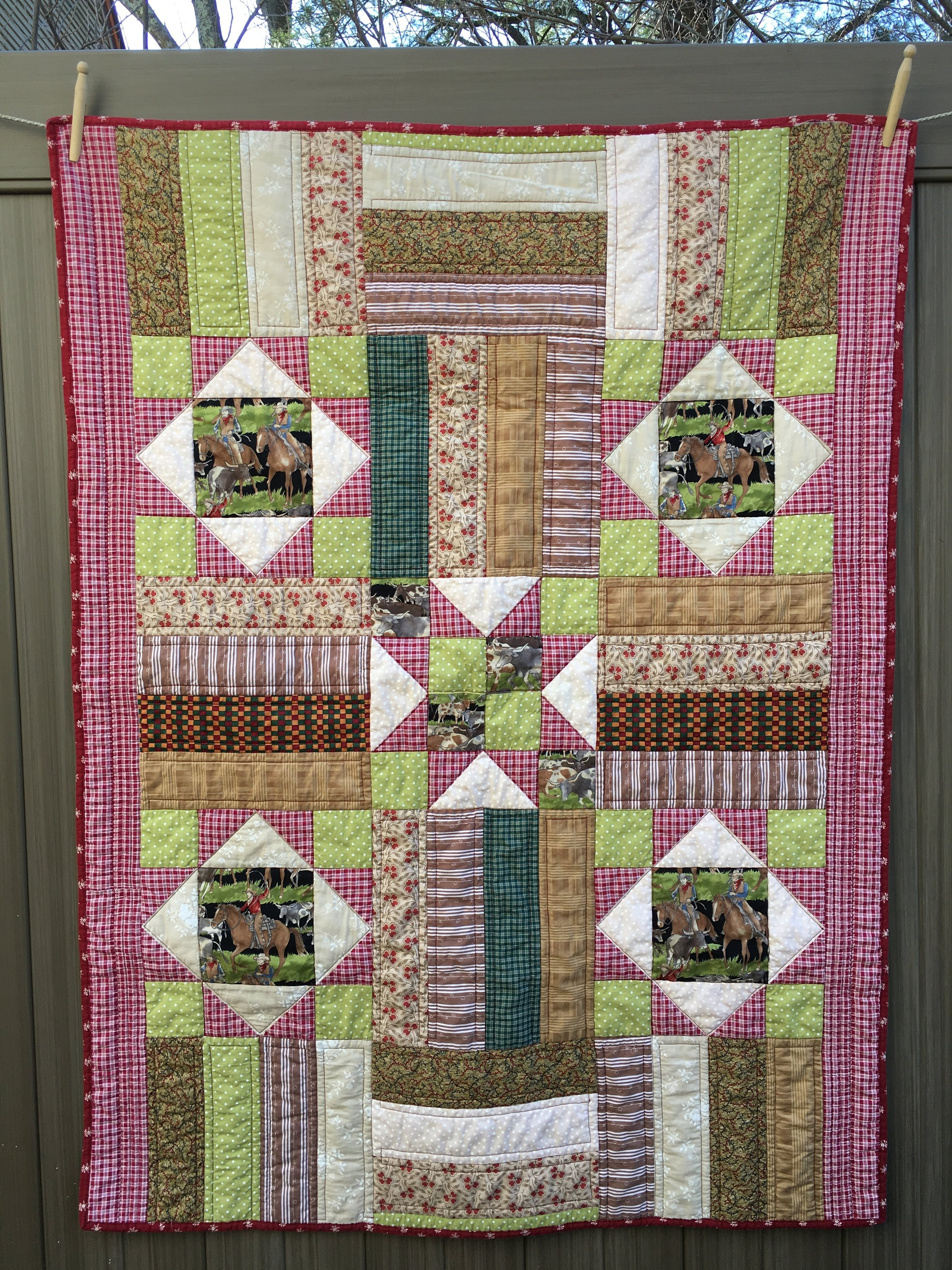"""Don't Fence Me In"" Flying Geese + Rail Fence Quilt,  approximate 42 inches x 55 inches."