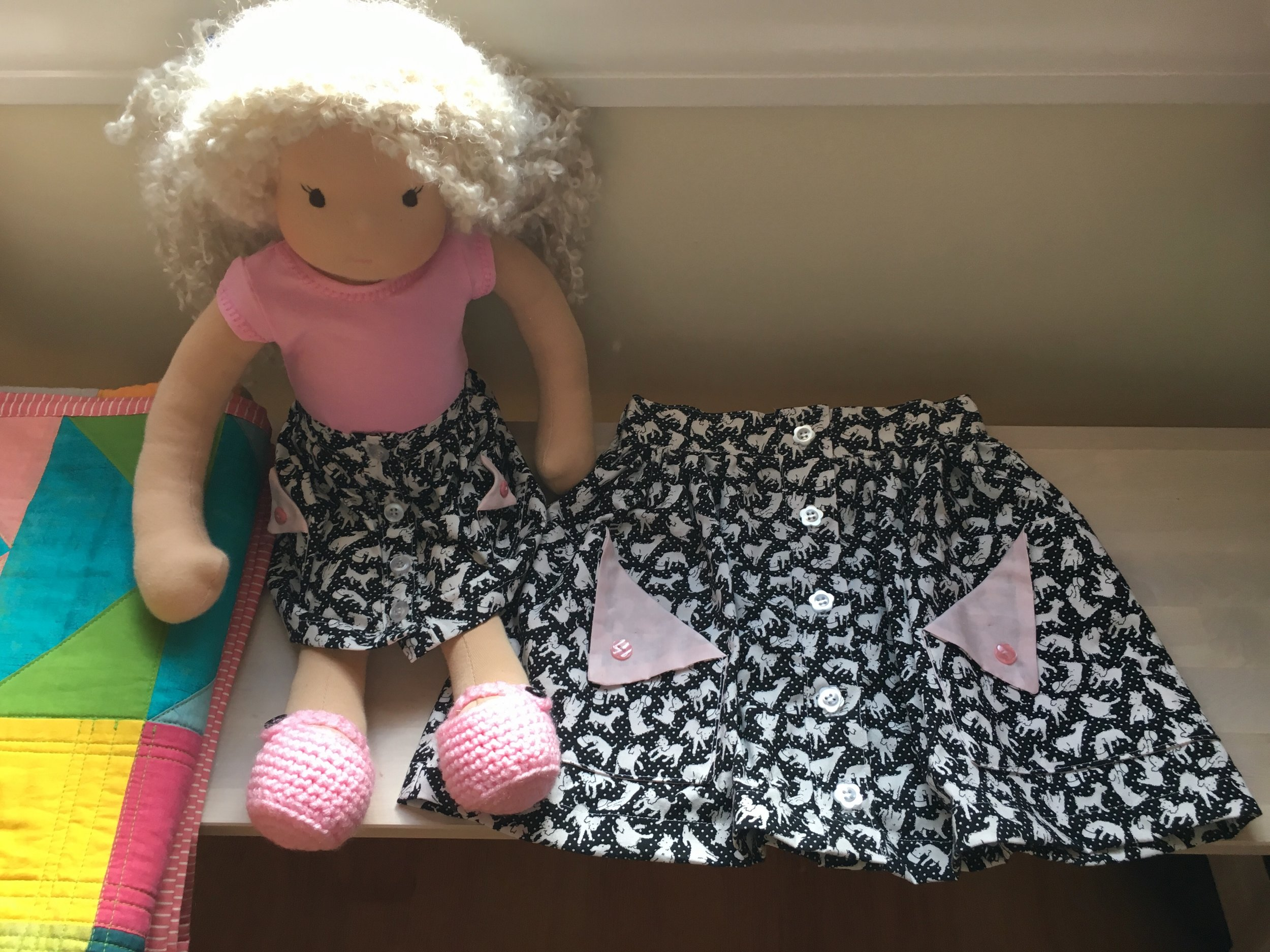 Olive ann designs Buttons Skirts and Pixie Faire T shirt. The doll is a Bamboletta Forever Friend.