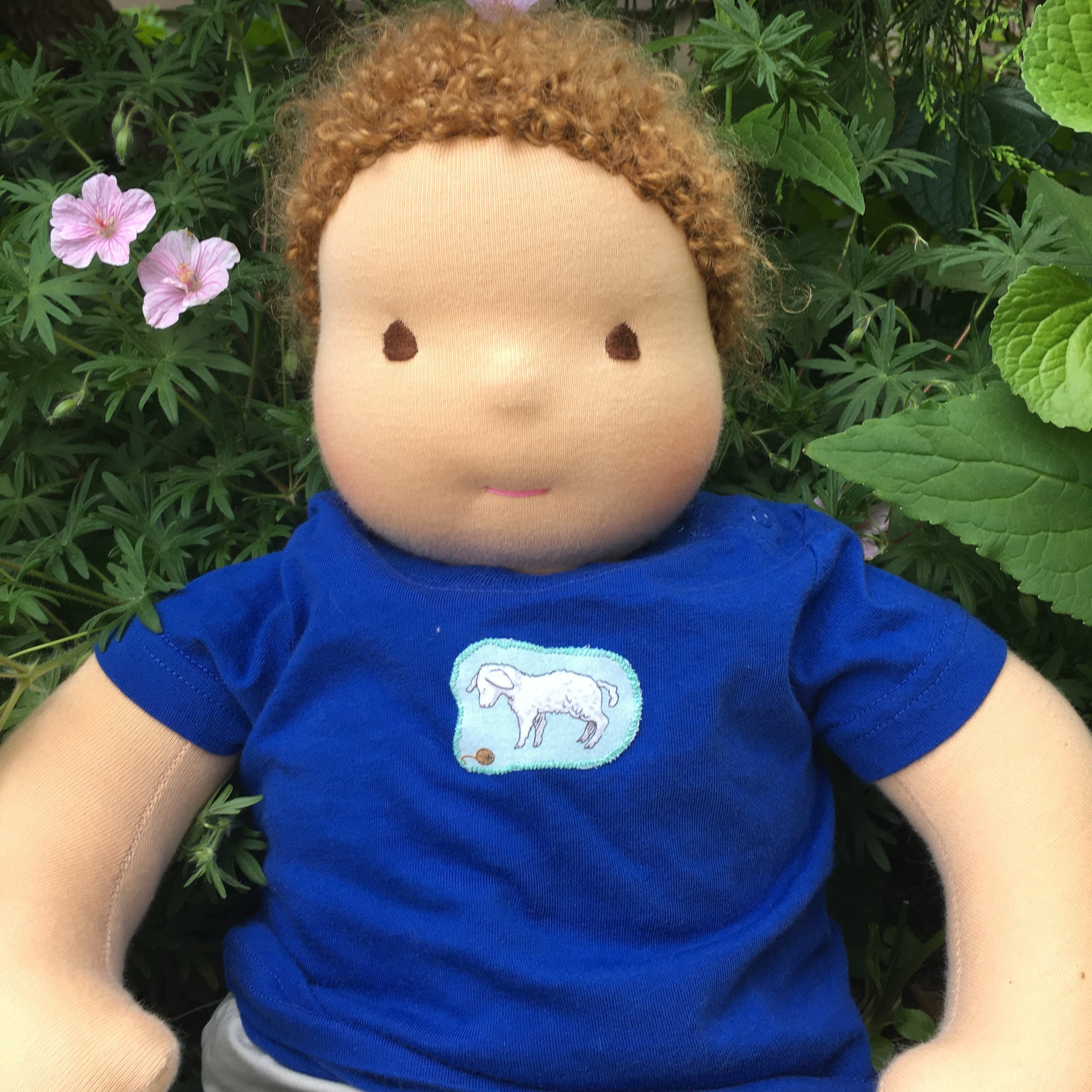 "Bamboletta  ""Big Baby"", sitting in for a real baby, wearing a T Shirt with an Applique"