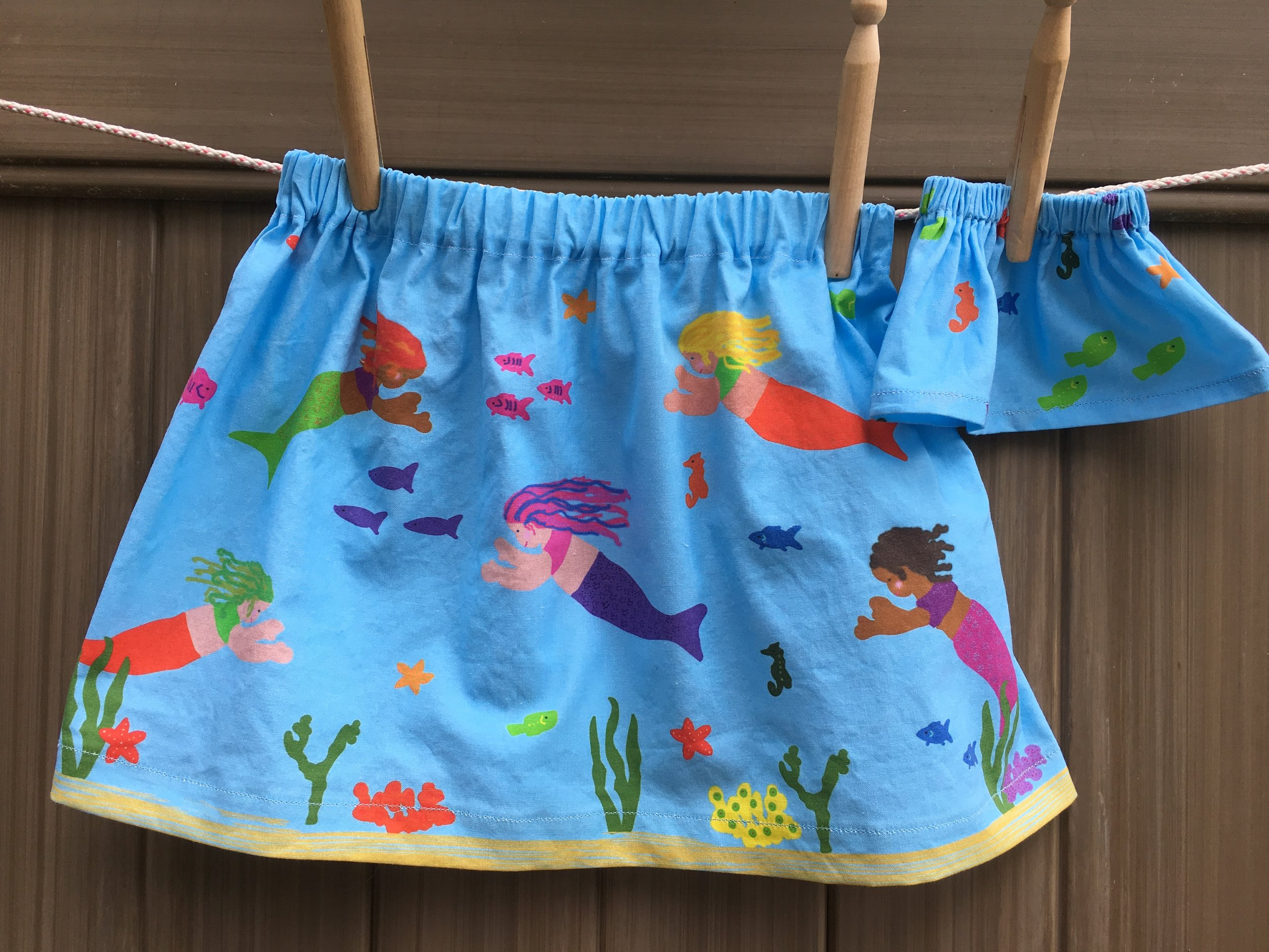 Mermaid Skirts for child and doll.  (Click link to open the tutorial). The mermaid fabric can be purchased from my  Spoonflower Shop .
