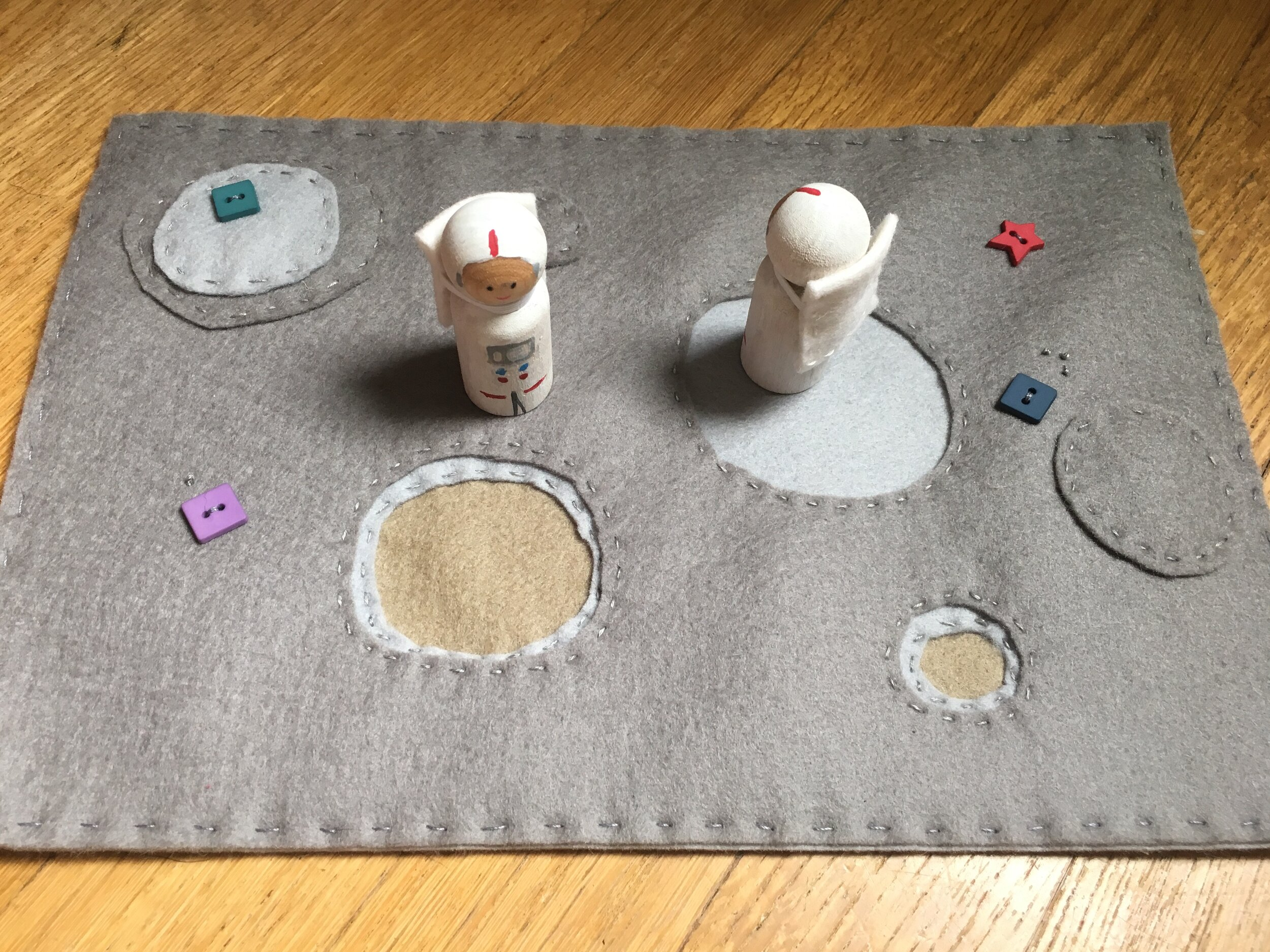 Felt lunar playscape with standard peg doll astronauts