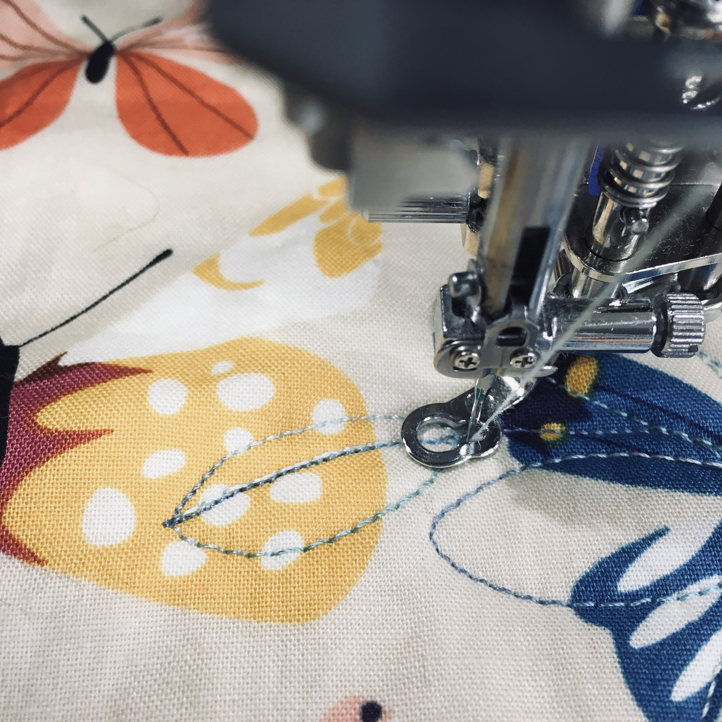 Travel stitching back along the stitches in the center of the leaf