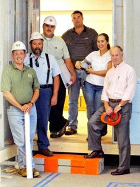 On the job at MaineGeneral Alfond Center for Health,  second from right  Theresa Thompson, President, Standard Waterproofing, Inc. stands with other contractors for the project.